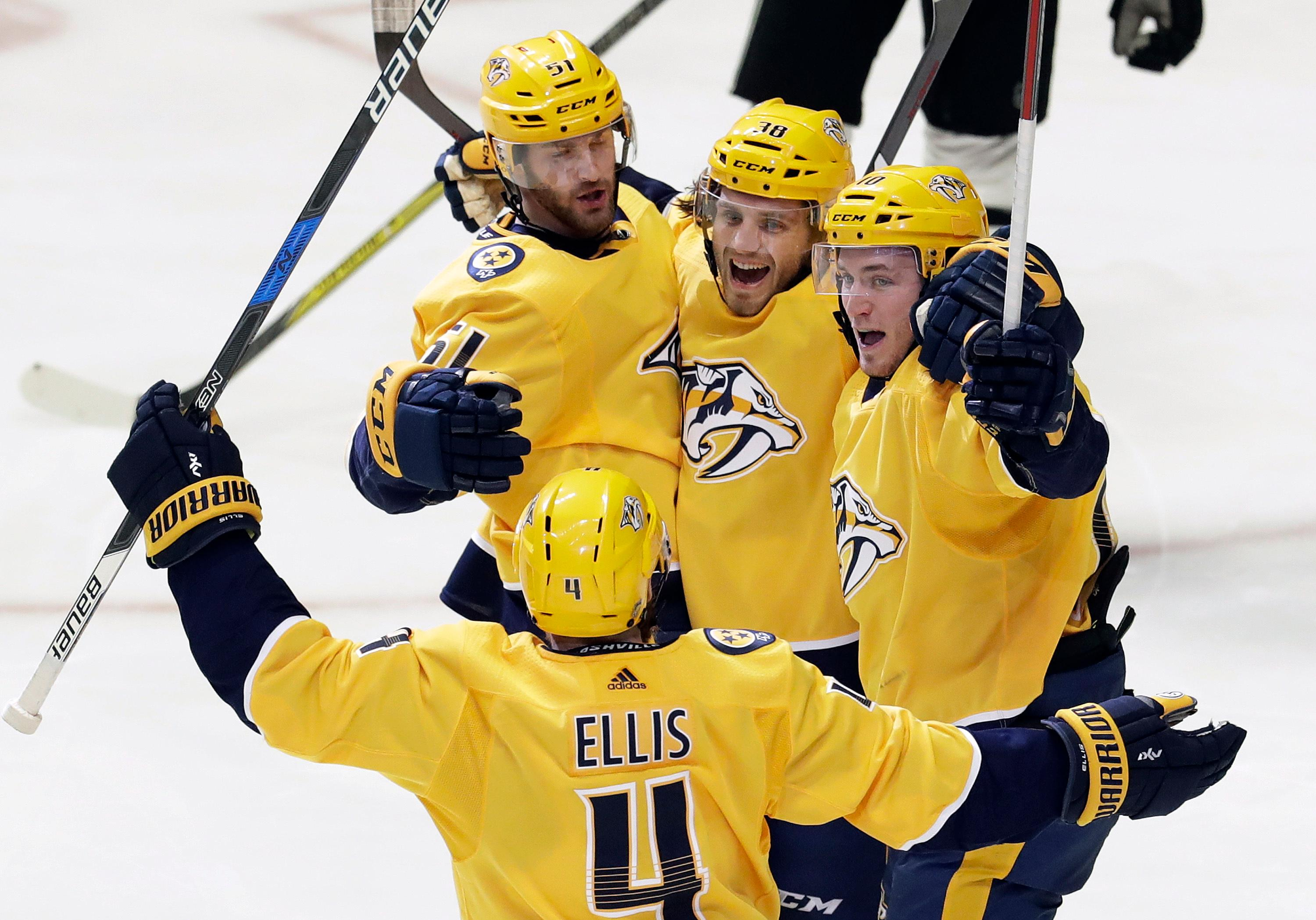 Nashville Predators right wing Ryan Hartman (38) celebrates with Ryan Ellis (4), Austin Watson (51) and Colton Sissons (10) after Hartman scored a goal against the Dallas Stars in the third period of an NHL hockey game Tuesday, March 6, 2018, in Nashville, Tenn. (AP Photo/Mark Humphrey)