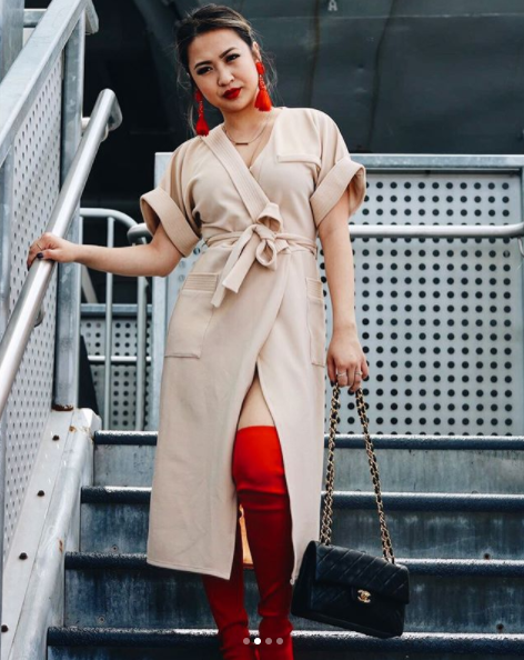 Vy i s a champ at rocking the colors, and we love how she added just the right pop of color through her coordinate orange earrings and boots, which pair nicely with the cream{&amp;nbsp;}kimono-ish-wrap-dress.(Image: Courtesy IG user @district.vy/{&amp;nbsp;}www.instagram.com/district.vy/)<p></p>