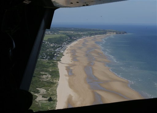 The view from one of the aircraft in U.S. President Barack Obama's squadron shows Omaha Beach, in France.