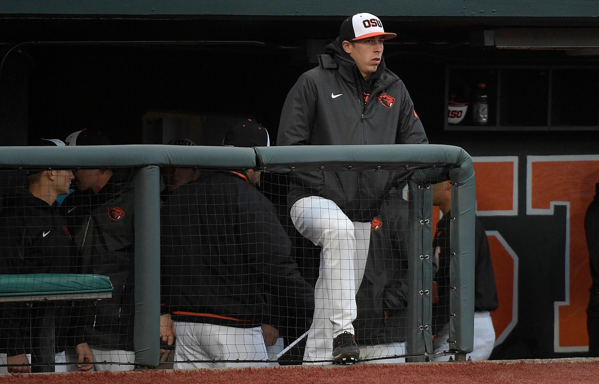 Oregon State's Luke Heimlich watches the team play Vanderbilt during an NCAA college baseball tournament super regional game Friday, June 9, 2017, in Corvallis, Ore. (Mark Ylen/Albany Democrat-Herald via AP)