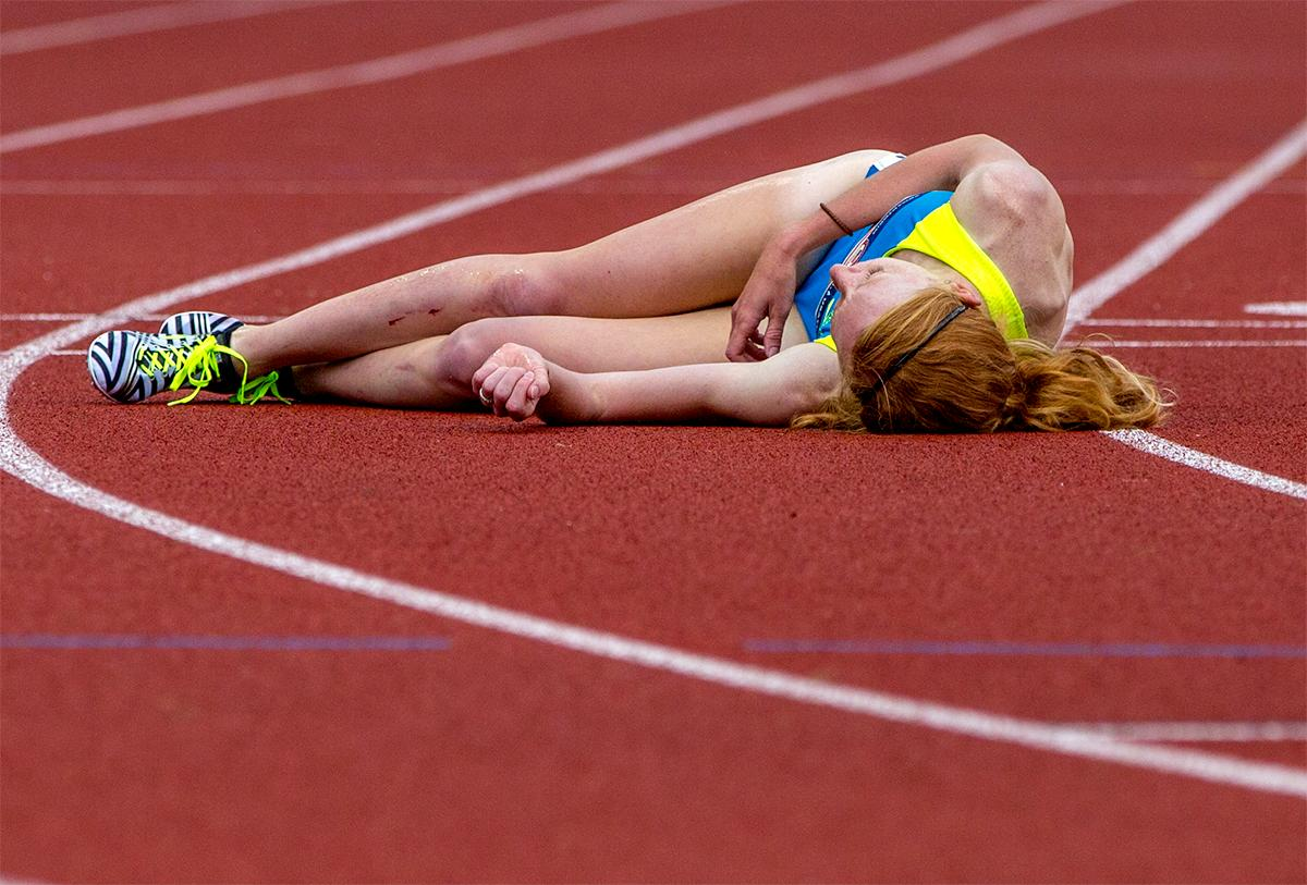 Brooks Amanda Eccleston lies on the track after tripping with another athlete at the finish of the 1,500 meters. Eccleston finished the race fourth with a time of 4:06.19. Photo by August Frank, Oregon News Lab