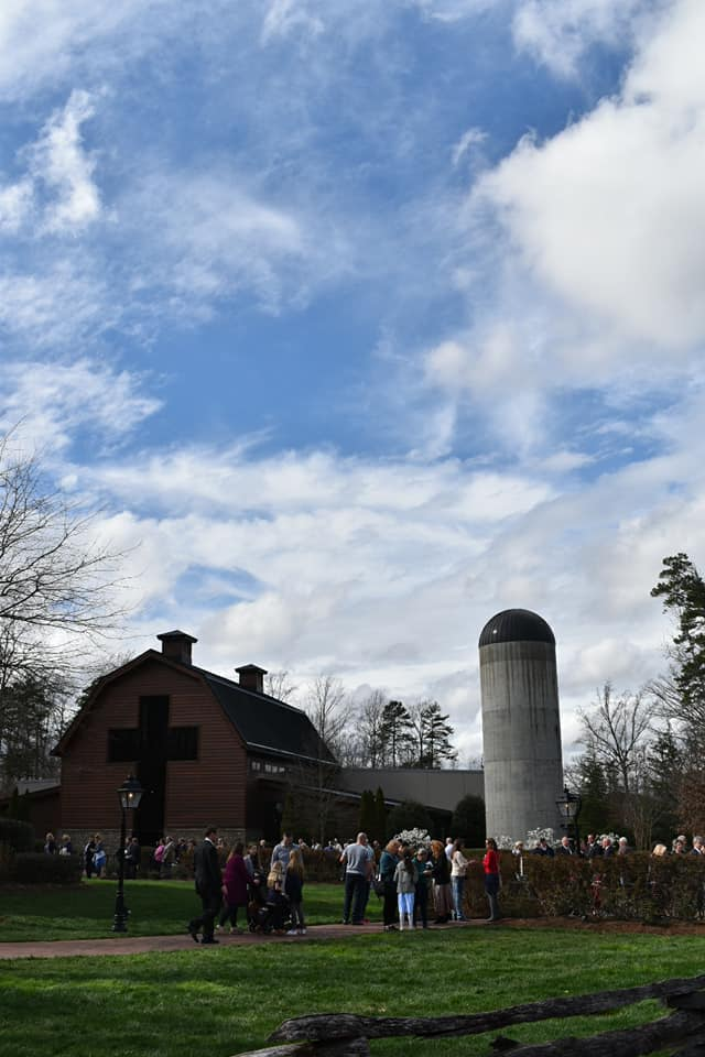 <p>People gather at the Billy Graham Library in Charlotte, North Carolina, on Feb. 26, 2018, to pay respects to the late Reverend Billy Graham, who died on Feb. 21.  (Photo credit: WLOS Staff)</p>