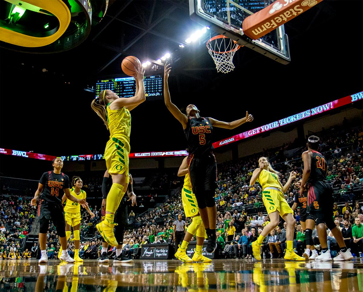 The Duck's Sabrina Ionescu (#20) goes for the rebound against USC. The Oregon Ducks defeated the USC Trojans 80-74 on Friday at Matthew Knight Arena in a  game that went into double overtime. Lexi Bando sealed the Ducks victory by scoring a three-pointer in the closing of the game. Ruthy Hebard set a new NCAA record of 30 consecutive field goals, the old record being 28. Ruthy Hebard got a double-double with 27 points and 10 rebounds, Mallory McGwire also had 10 rebounds. The ducks had four players in double digits. The Ducks are now 24-4, 13-2 in the Pac-12, and are tied for first with Stanford. Photo by August Frank, Oregon News Lab