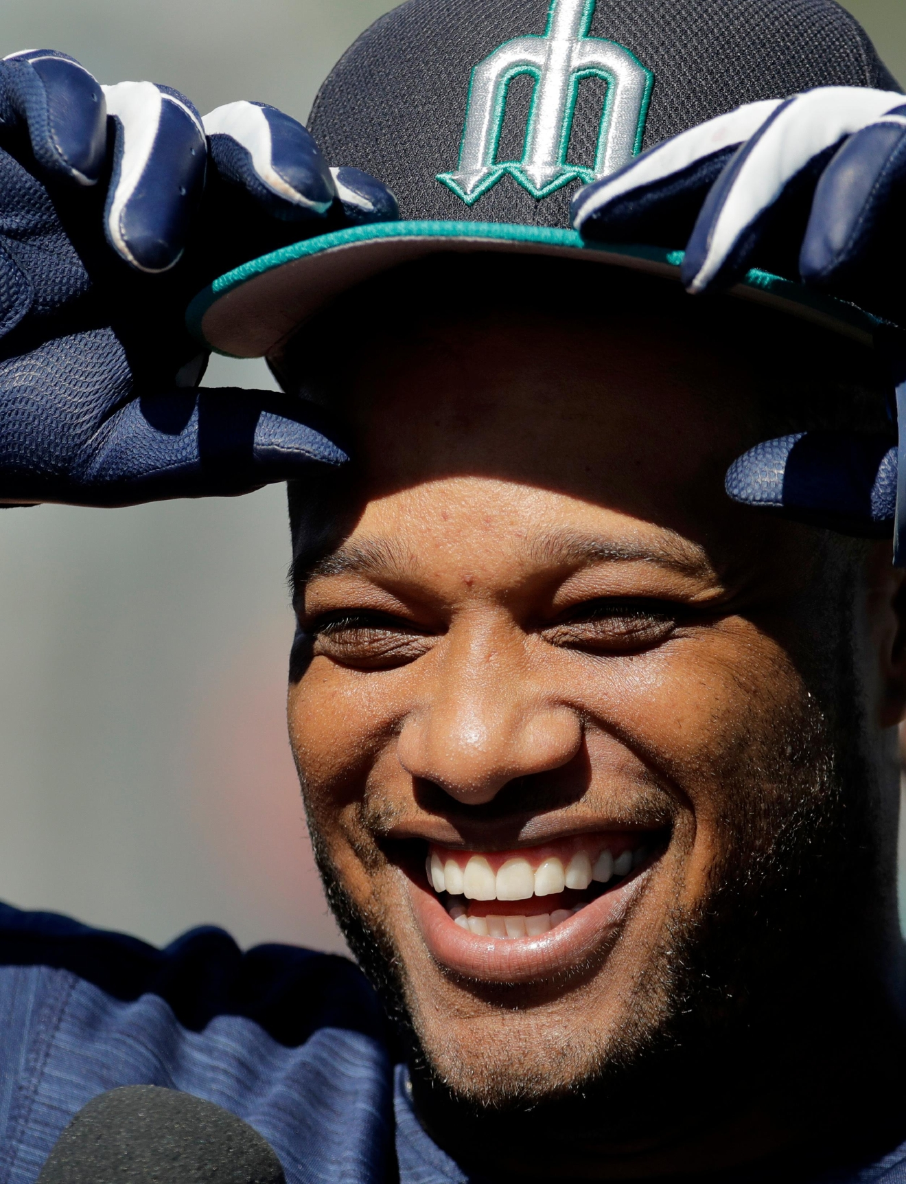Seattle Mariners' Robinson Cano adjusts his cap during spring training baseball practice, Tuesday, Feb. 21, 2017, in Peoria, Ariz. (AP Photo/Charlie Riedel)