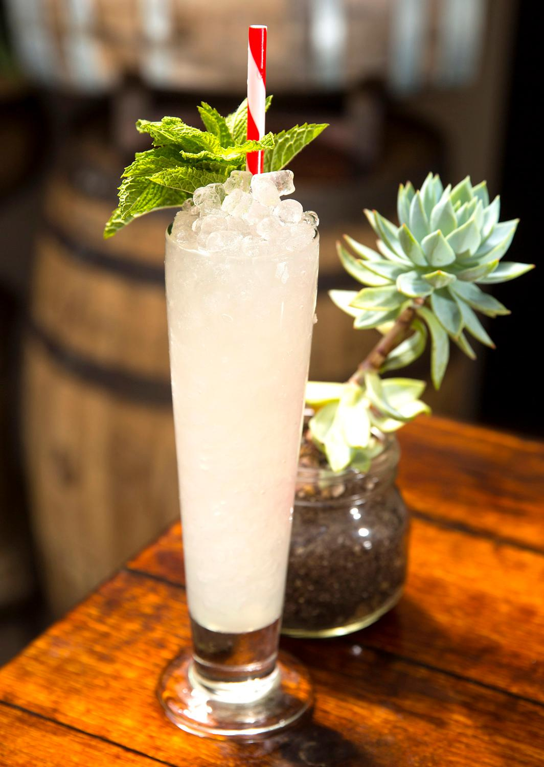 Can't Stand the Rain from Herb &amp;amp; Bitter, made up from{&amp;nbsp;}mezcal, tequila, pear brandy, lime juice, a liqueur made from the resin of the mastic tree, Crème de menthe and topped with mint garnish. (Sy Bean / Seattle Refined)<p></p>