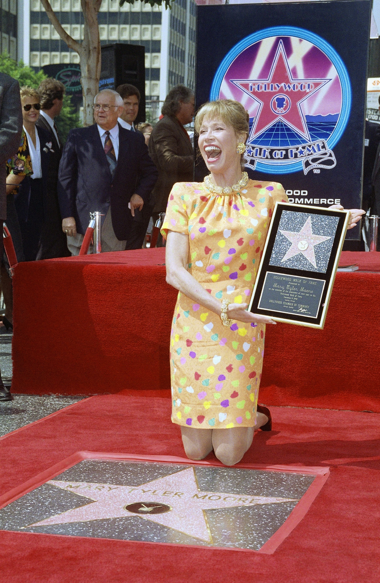 Actress Mary Tyler Moore reacts to fans and media after being honored with her star on Hollywood?s famed walk, Tuesday, Sept. 8, 1992 in Los Angeles. Moore, who has won five Emmy Awards for her work in ?The Dick Van Dyke Show? and ?The Mary Tyler Moore Show?, was given the 1,963rd star on the famous walk. Moore was also nominated for an Academy Award for her role in ?Ordinary People.? (AP Photo/Chris Martinez)