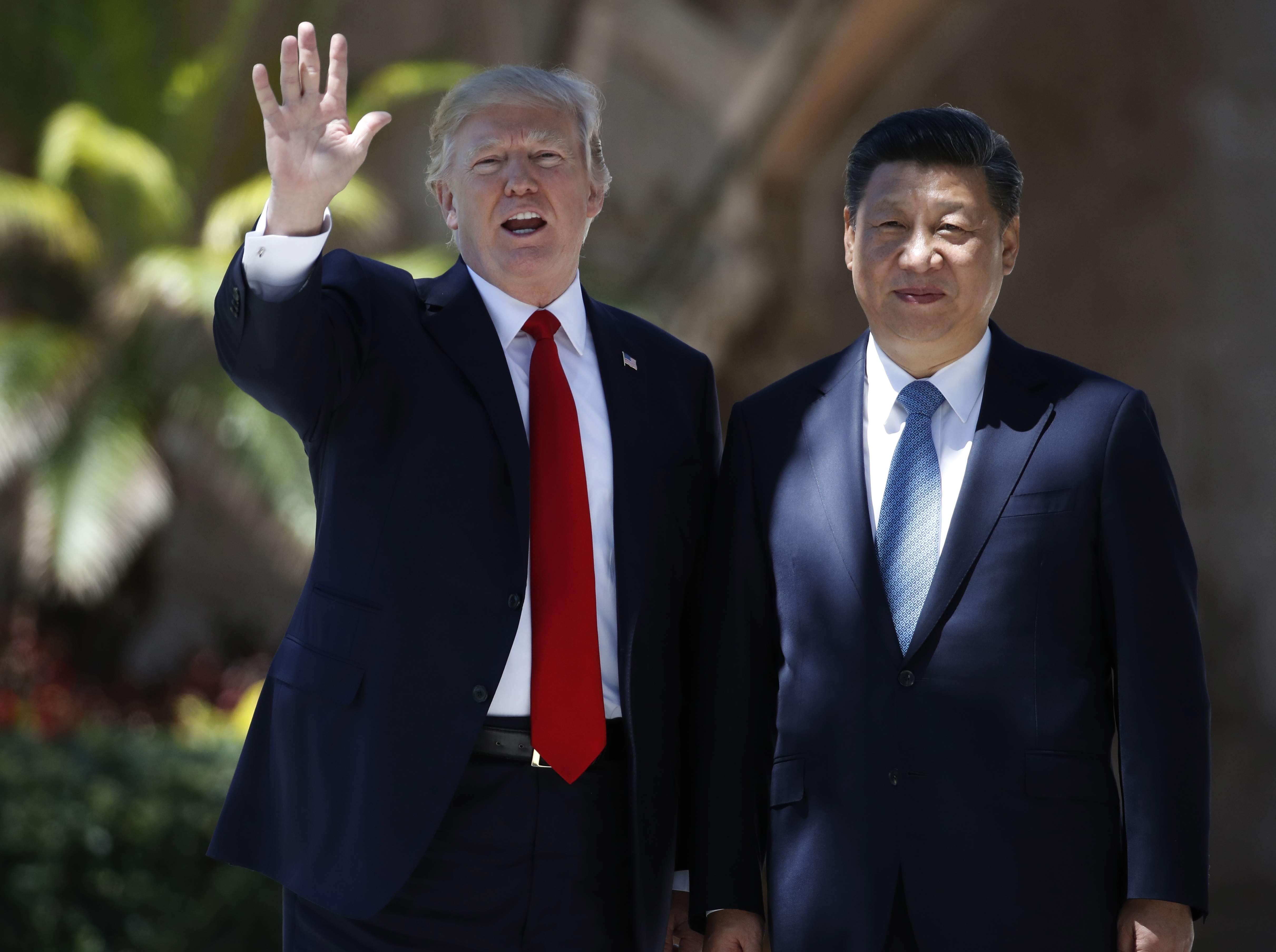 DAY 78 - In this April 7, 2017, file photo, President Donald Trump and Chinese President Xi Jinping pause for photographs at Mar-a-Lago, in Palm Beach, Fla. (AP Photo/Alex Brandon, File)