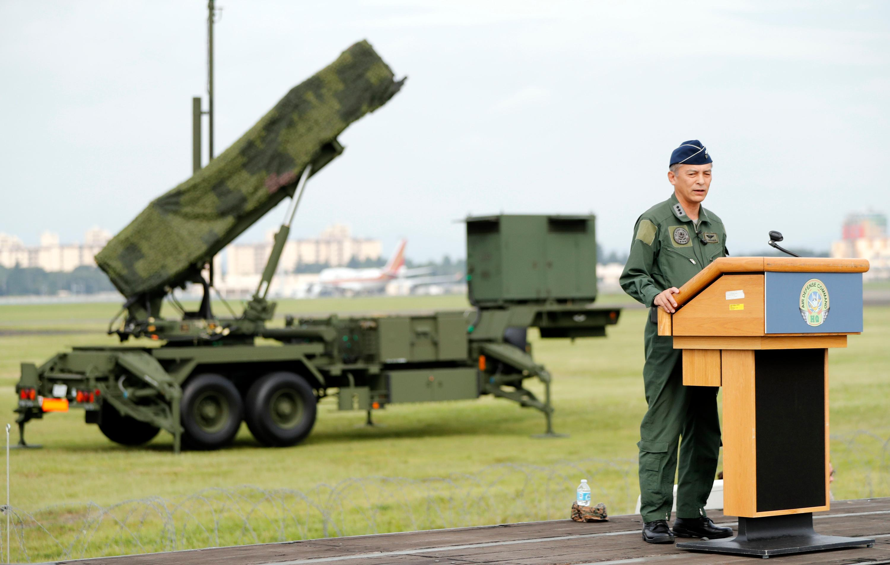 Lt. Gen. Hiroaki Maehara, the commander of the Air Self-Defense Forces, delivers a speech in front of Japanese Air Self Defense Force (JASDF) demonstrating the training to utilize the PAC-3 surface to air interceptors at the U.S. Yokota Air Base in Fussa, on the outskirts of Tokyo Tuesday, Aug. 29, 2017. (AP Photo/Eugene Hoshiko)