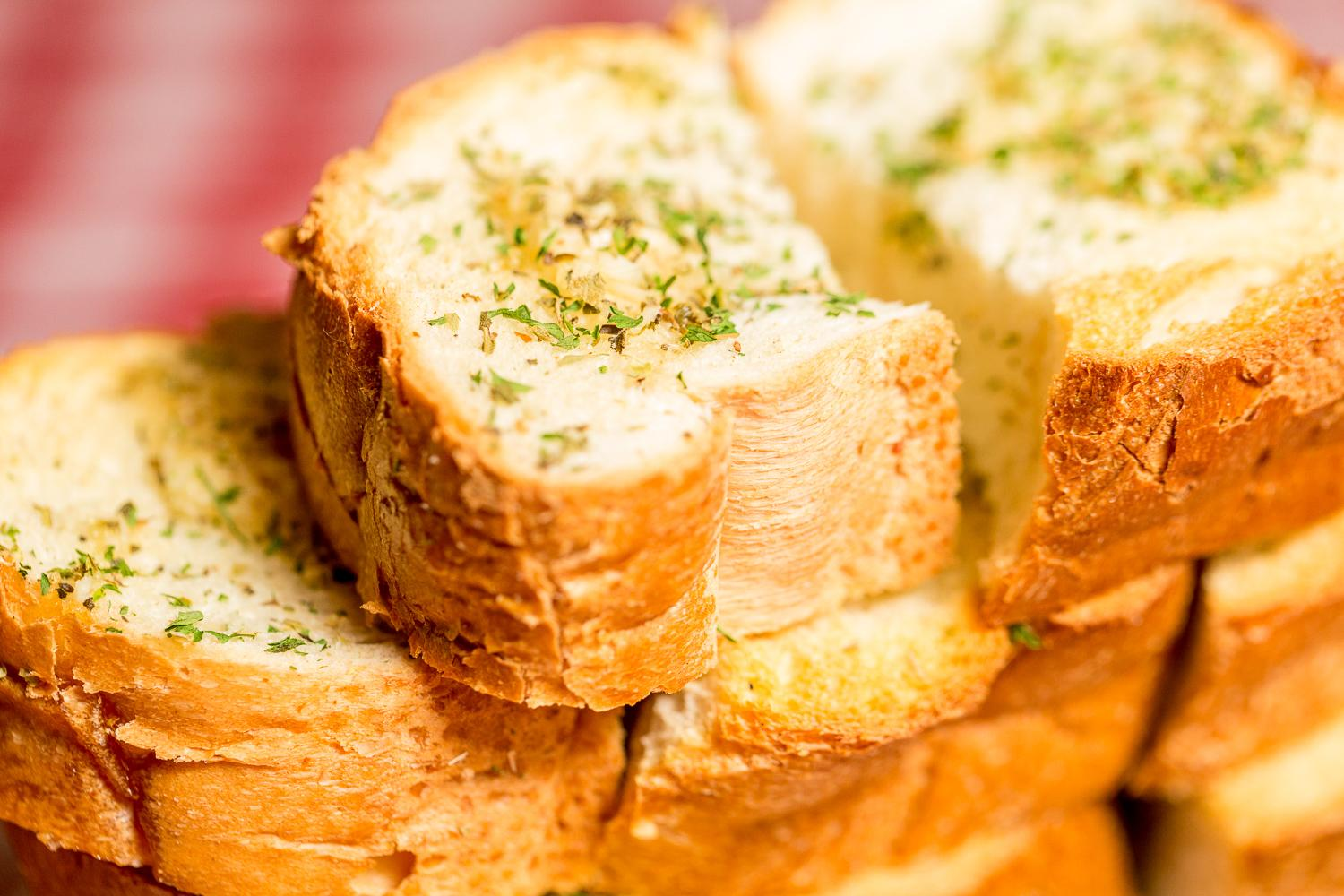 A mountain of Scotti's toasted Italian garlic bread / Image: Daniel Smyth Photography