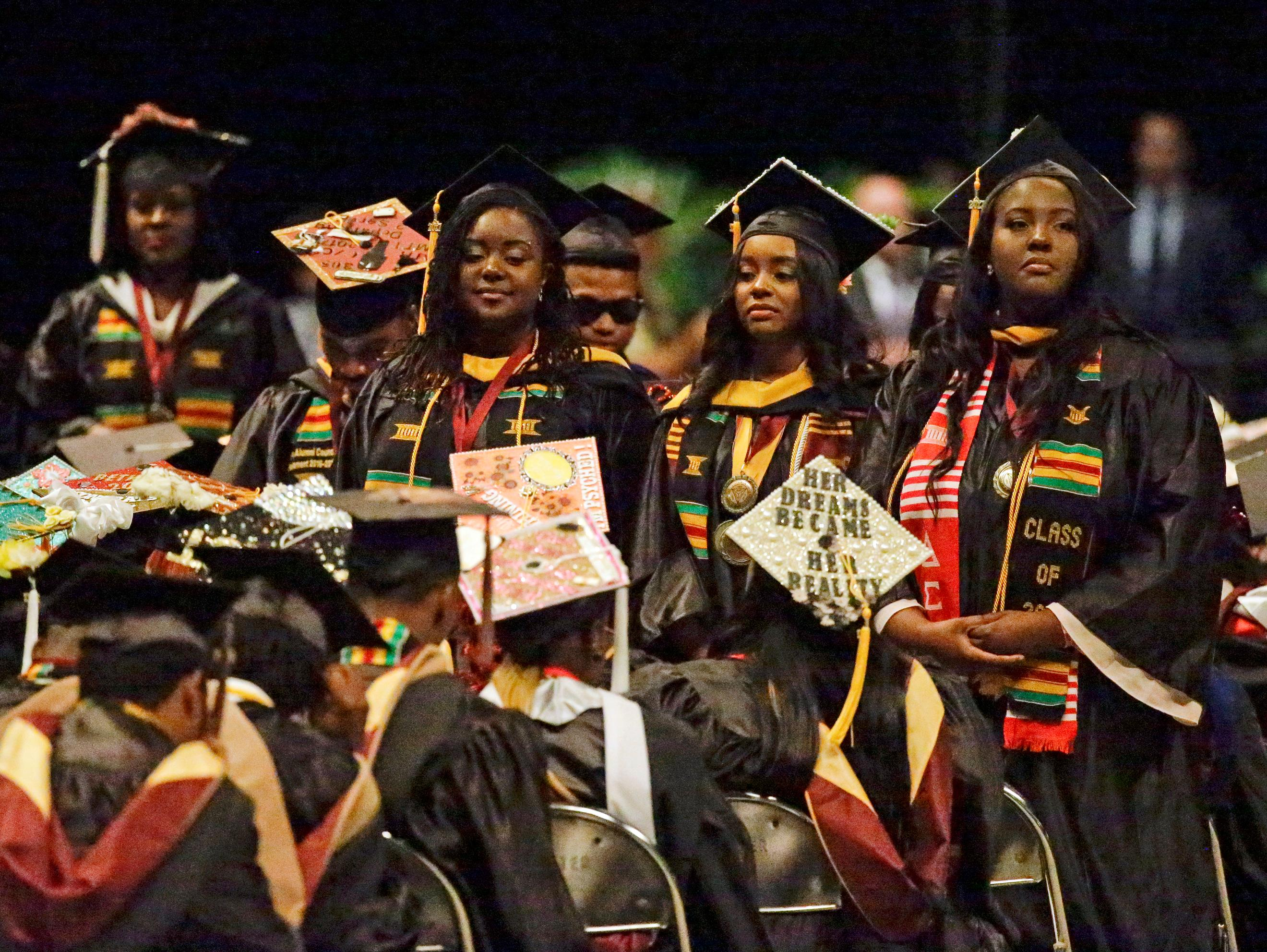 A group of students stand and turn their backs during a commencement exercise speech by Education Secretary Betsy DeVos at Bethune-Cookman University, Wednesday, May 10, 2017, in Daytona Beach, Fla. (AP Photo/John Raoux)