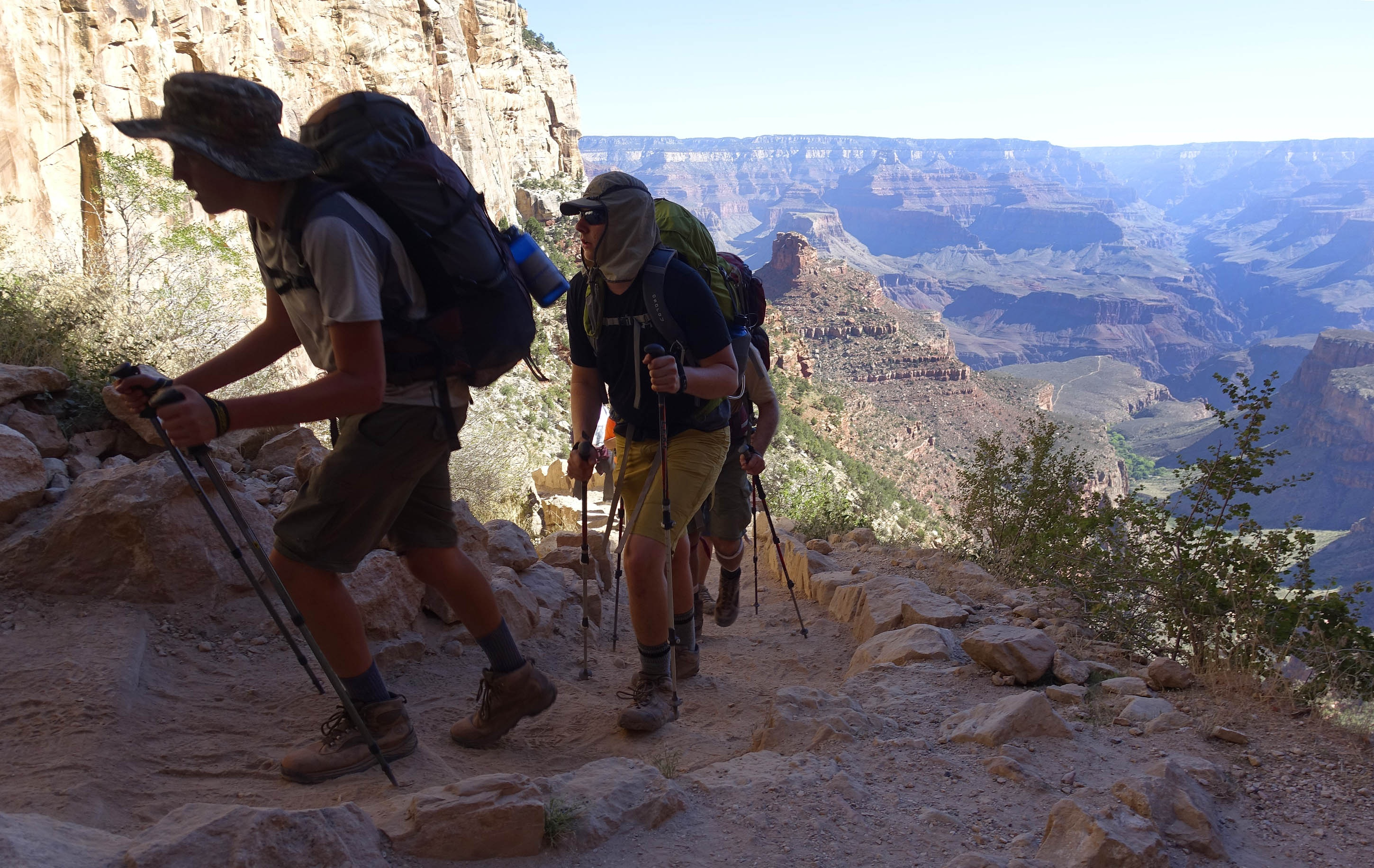 FILE - In this July 27, 2015, file photo, a long line of hikers head out of the Grand Canyon along the Bright Angel Trail at Grand Canyon National Park, Ariz. The National Park Service is floating a proposal to increase entrance fees at 17 of its most popular sites next year. (AP Photo/Ross D. Franklin, File)