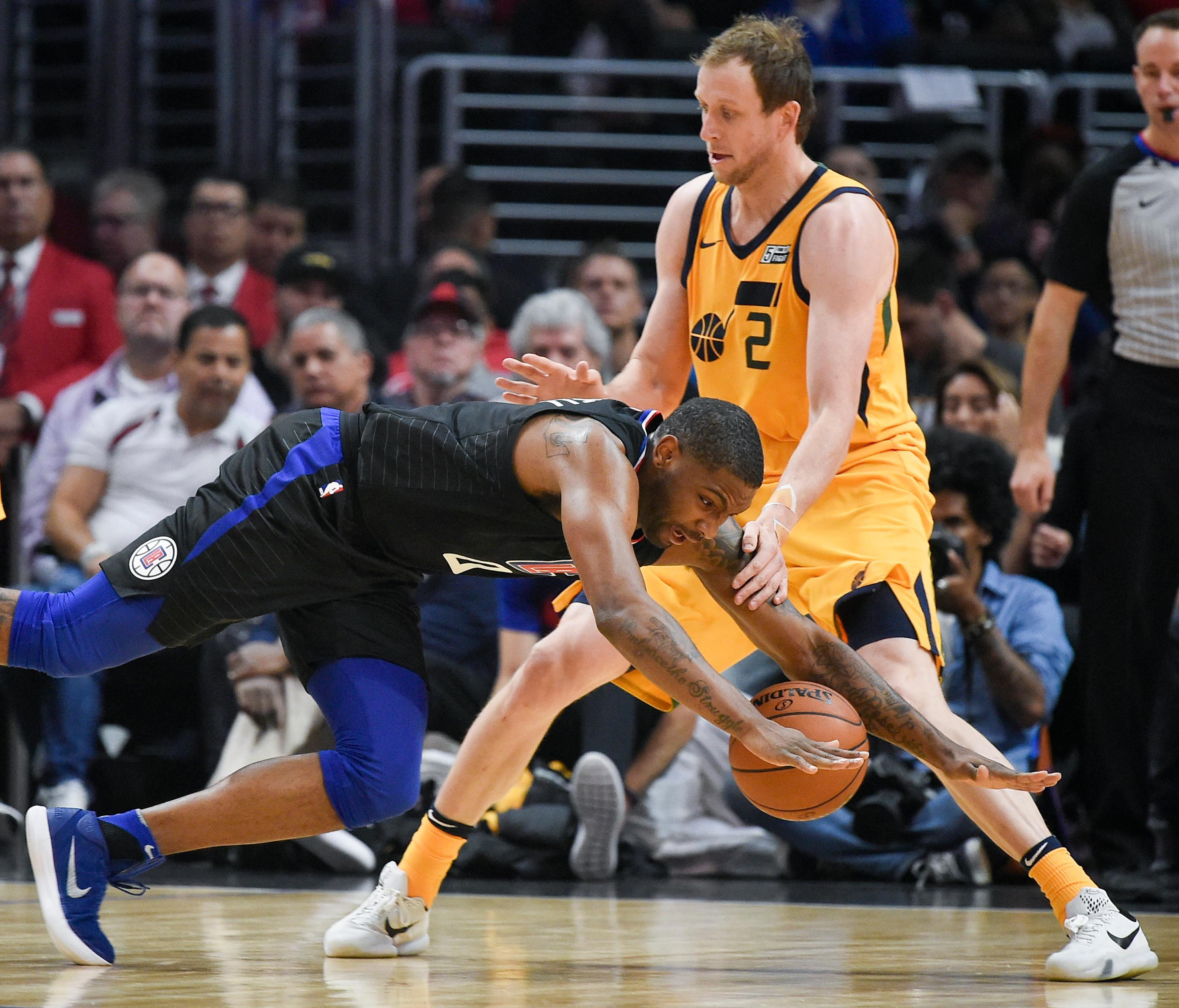 Los Angeles Clippers guard Sindarius Thornwell, front, loses the ball as he falls to the court while Utah Jazz forward Joe Ingles defends during the first half of an NBA basketball game in Los Angeles, Thursday, Nov. 30, 2017. (AP Photo/Kelvin Kuo)
