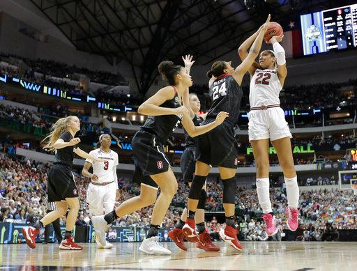 South Carolina forward A'ja Wilson (22) shoots over Stanford forward Erica McCall (24) during the second half of an NCAA college basketball game in the semifinals of the women's Final Four, Friday, March 31, 2017, in Dallas. (AP Photo/Tony Gutierrez)