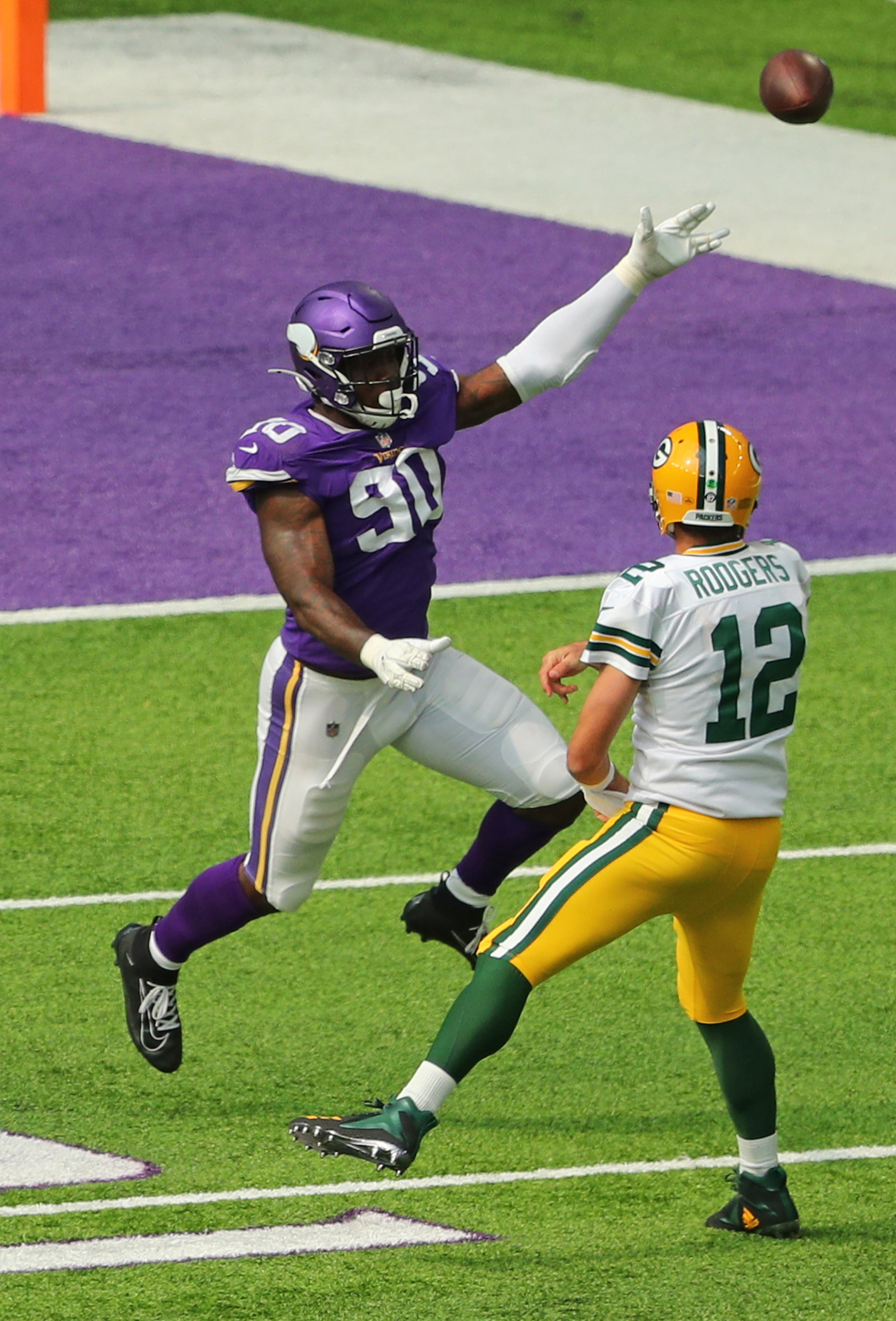 MINNEAPOLIS, MN - SEPTEMBER 13: Aaron Rodgers #12 of the Green Bay Packers passes while under pressure from Jalyn Holmes #90 of the Minnesota Vikings in the fourth quarter against the Minnesota Vikings at U.S. Bank Stadium on September 13, 2020 in Minneapolis, Minnesota. The Green Bay Packers defeated the Minnesota Vikings 43-34.(Photo by Adam Bettcher/Getty Images)