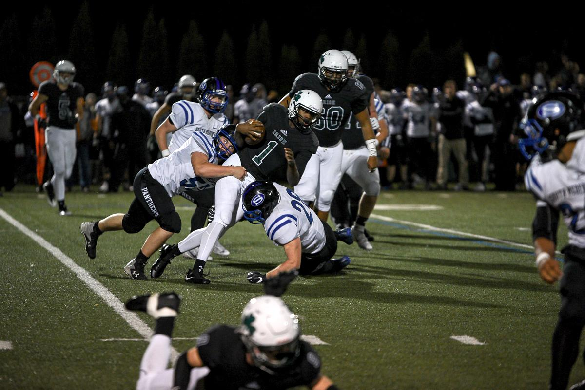 Sheldon quarterback Micheal Johnson (#1) racks up yardage during Sheldon's 31-14 defeat to South Medford. Photo by Jeff Dean, Oregon News Lab