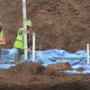 Construction crews dig up human remains of more than 20 people while building a school