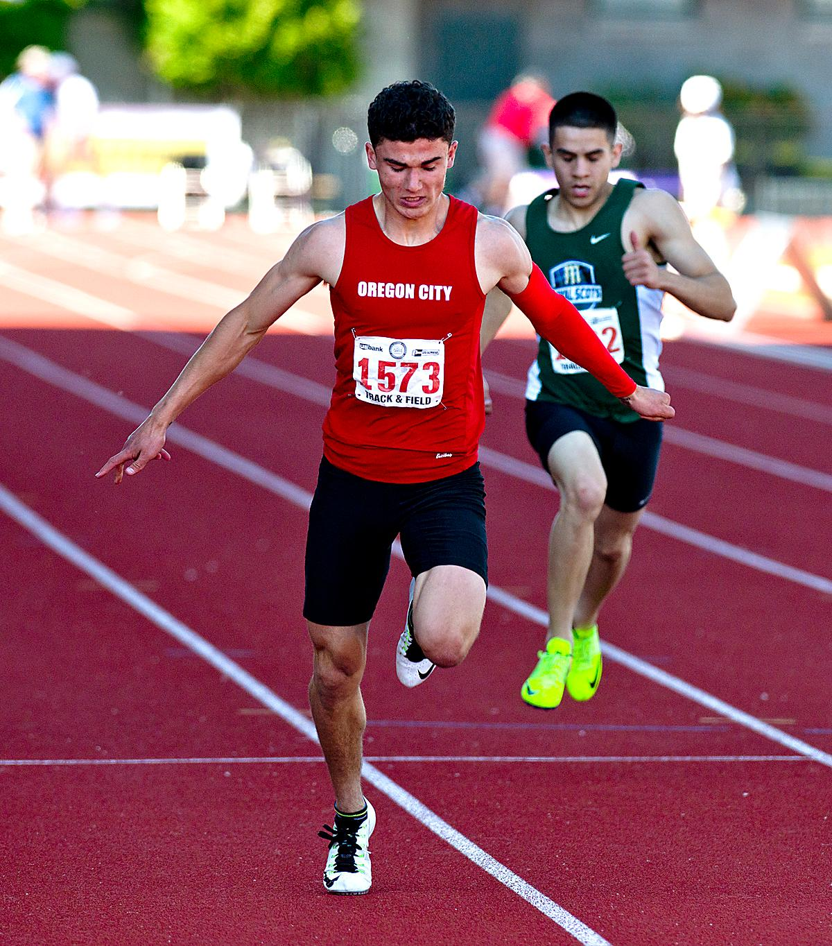 Rieker Daniel from Oregon City wins the 6A Boys 200 meter Dash with a time of 21.49 at the OSAA Championship at Hayward Field this Saturday. Photo by Dan Morrison, Oregon News Lab