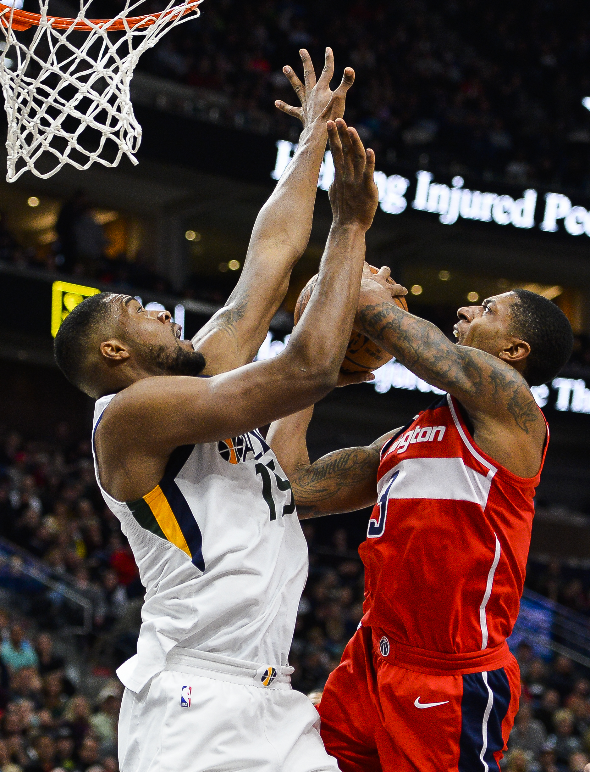 Utah Jazz forward Derrick Favors (15) attempts to block Washington Wizards guard Bradley Beal (3) in the first half of an NBA basketball game Monday, Dec. 4, 2017, in Salt Lake City. (AP Photo/Alex Goodlett)