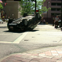 Drivers walk away unhurt after car flips in downtown crash