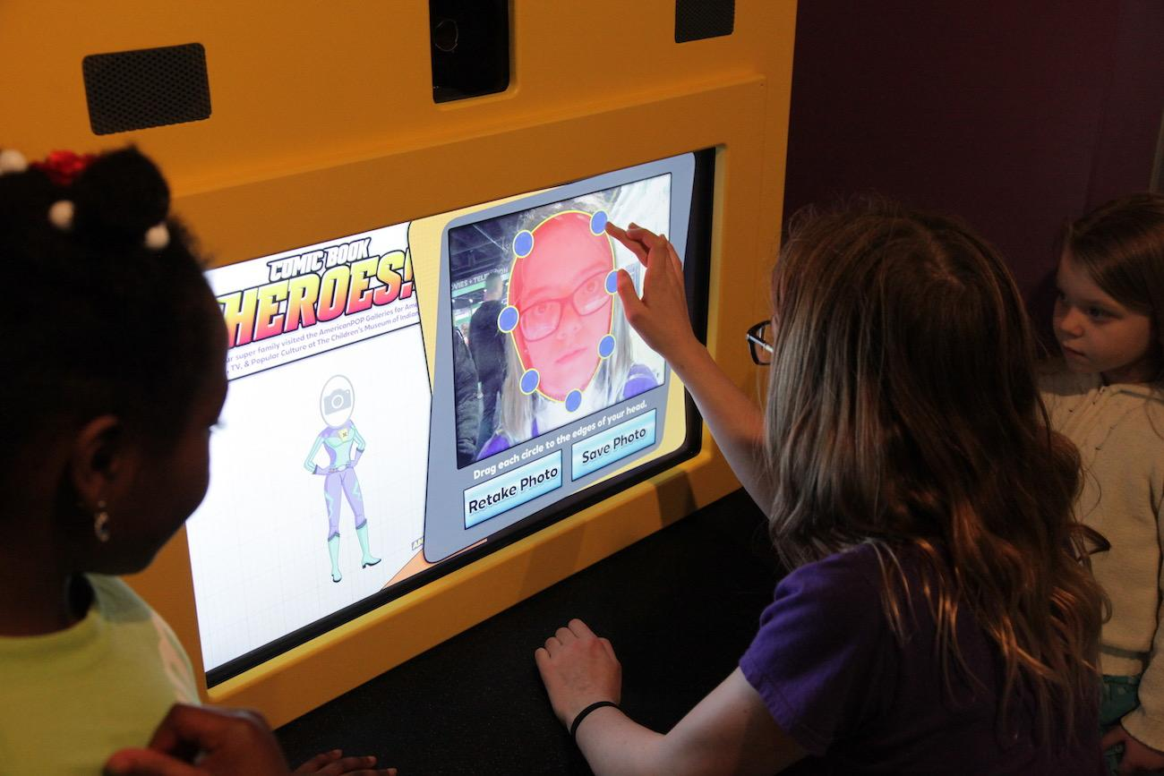 Kids try their hand at designing comic books, starring themselves, in an exhibit about comic book heroes. / Image: Chez Chesak // Published: 4.2.19