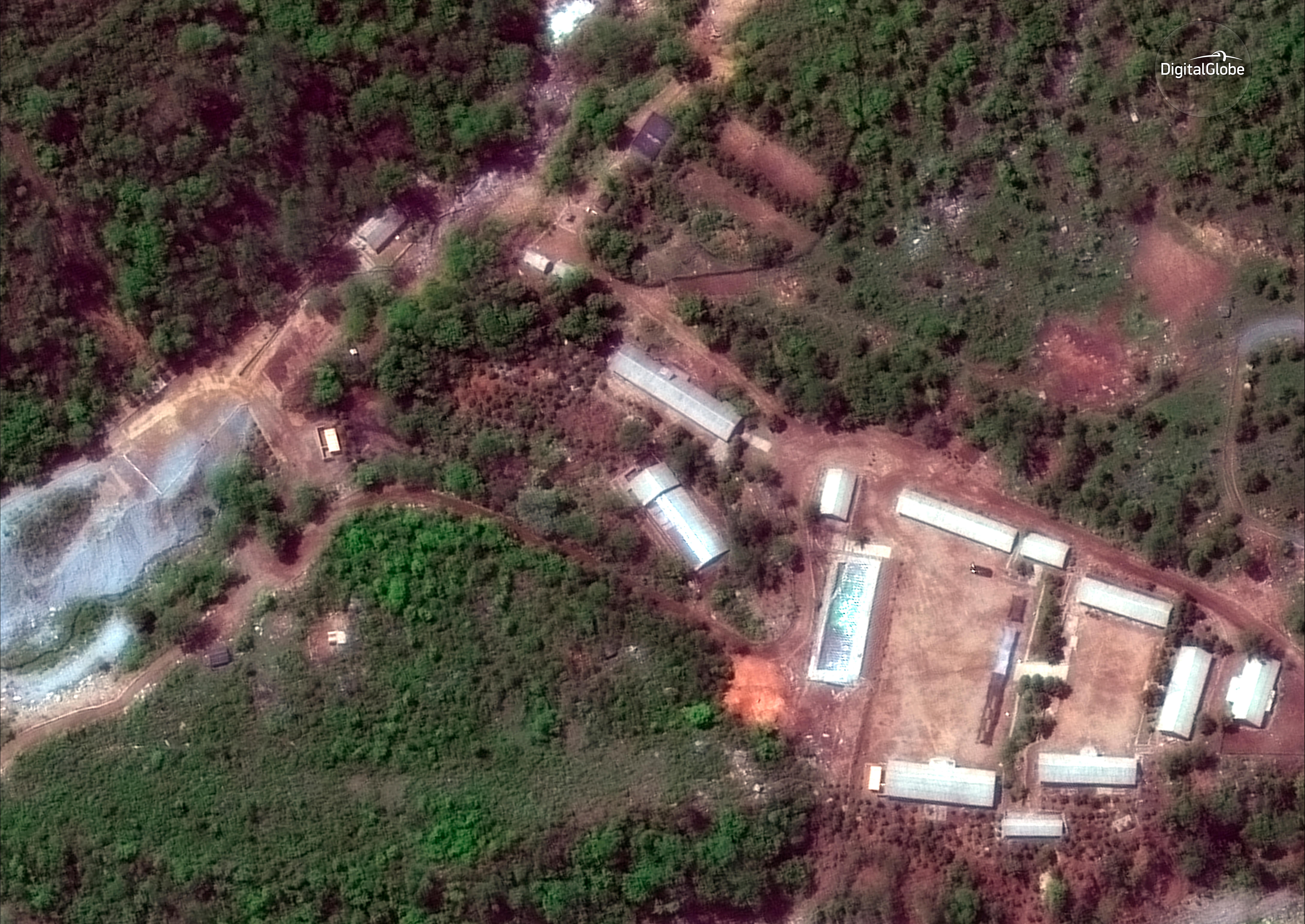 FILE - This Wednesday, May 23, 2018 satellite file image provided by DigitalGlobe, shows the Punggye-ri test site in North Korea. North Korea has carried out what it says is the demolition of its nuclear test site in the presence of foreign journalists. The demolition happened Thursday at the site deep in the mountains of the North's sparsely populated northeast. The planned closing was previously announced by leader Kim Jong Un ahead of his planned summit with U.S. President Donald Trump next month. (DigitalGlobe via AP, File)