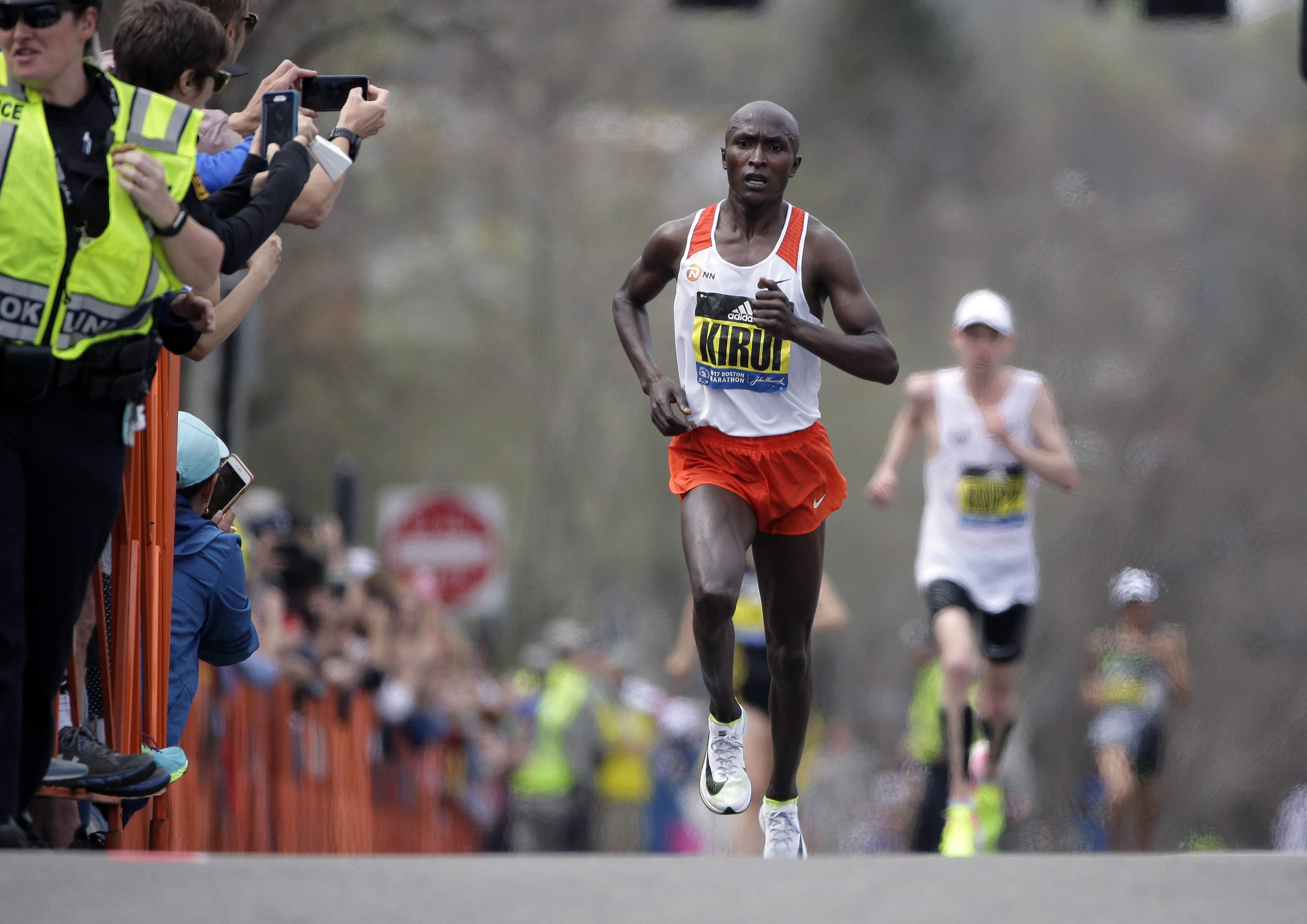Geoffrey Kirui, of Kenya, leads Galen Rupp, of the United States, and the rest of the field along the course of the 121st Boston Marathon on Monday, April 17, 2017, in Brookline, Mass. THE ASSOCIATED PRESS