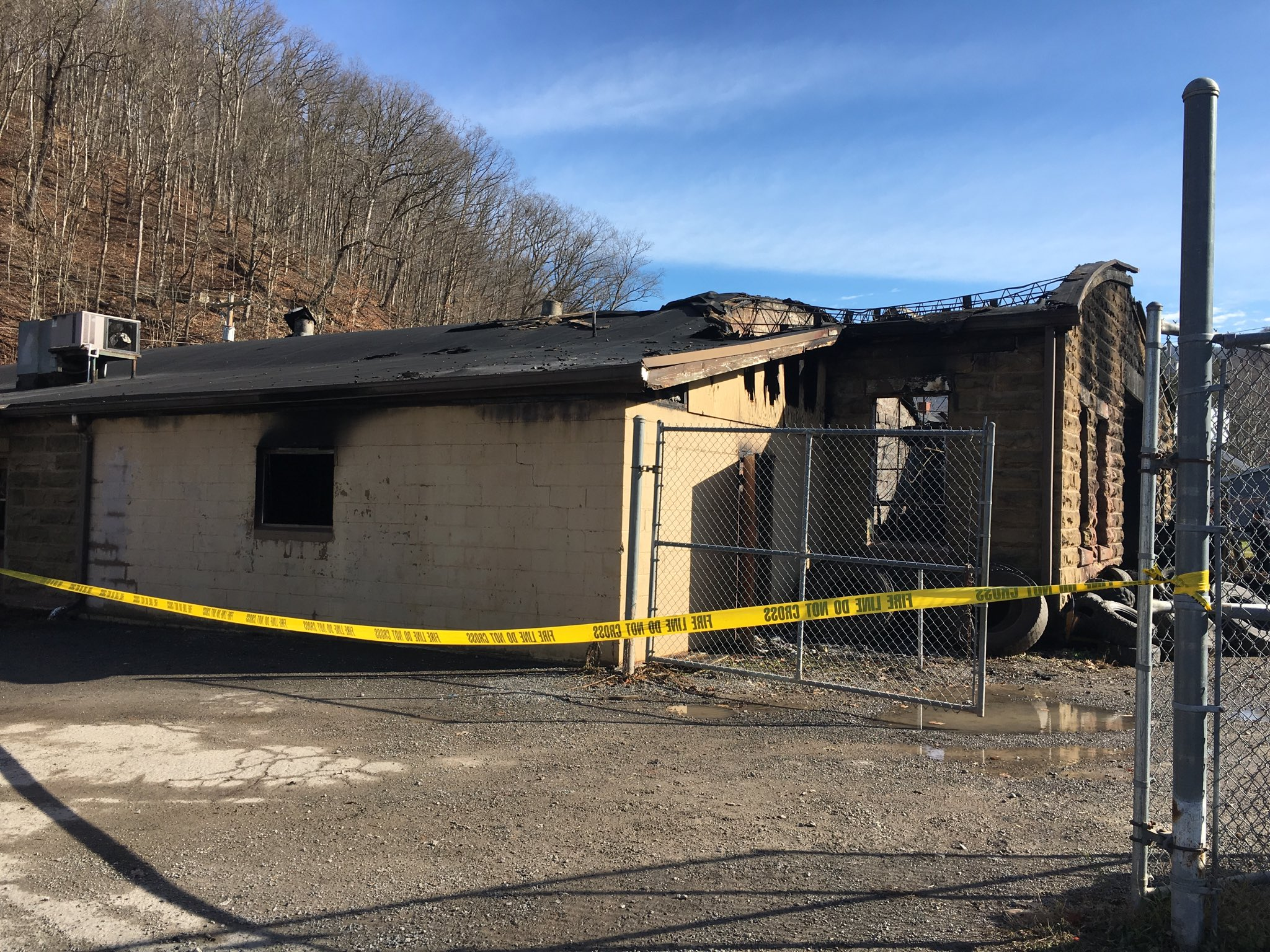 Photo shows a roof that was partially destroyed in a blaze that killed{&amp;nbsp;} transportation worker Stephen M. Cogar at the state Division of Highways garage in Webster County. (WCHS/WVAH)<p></p>