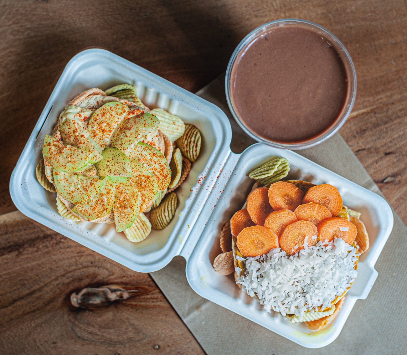 Curry Coconut Baglette (half bagel or gluten free English muffin with house vegan curry spread and topped with shredded coconut with veggie chips on the side) and Curry Carrot Baglette (half bagel or a gluten free English muffin with house vegan curry spread, topped with carrot with veggie chips on the side) / Image: Kellie Coleman // Published: 12.27.20