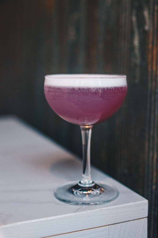 Ashley Grutza: pea blossom vodka, lavender, lime, egg white, and Peychaud's bitters /  Image: Catherine Viox // Published: 10.23.18