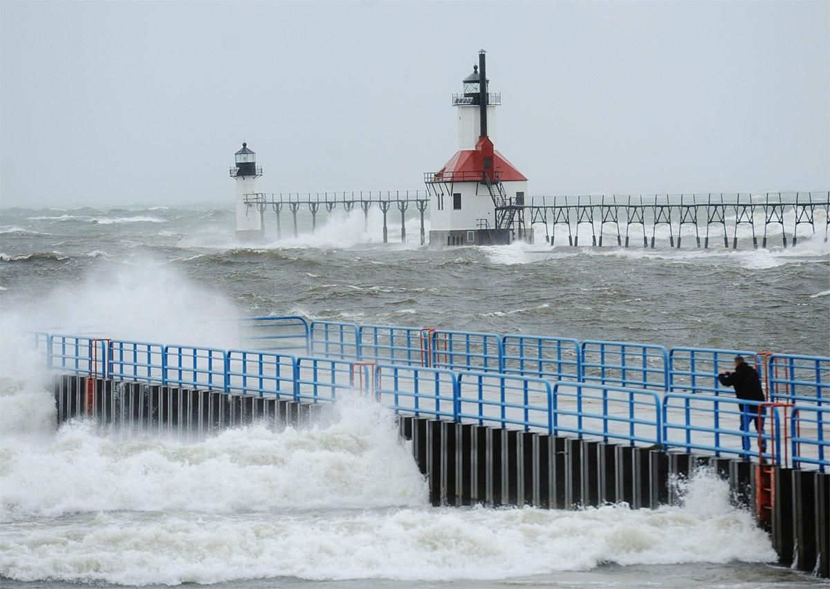 Lake Michigan waves crash into the north and south piers Saturday, Nov. 19, 2016, in St. Joseph, Mich.   (Don Campbell/The Herald-Palladium via AP)