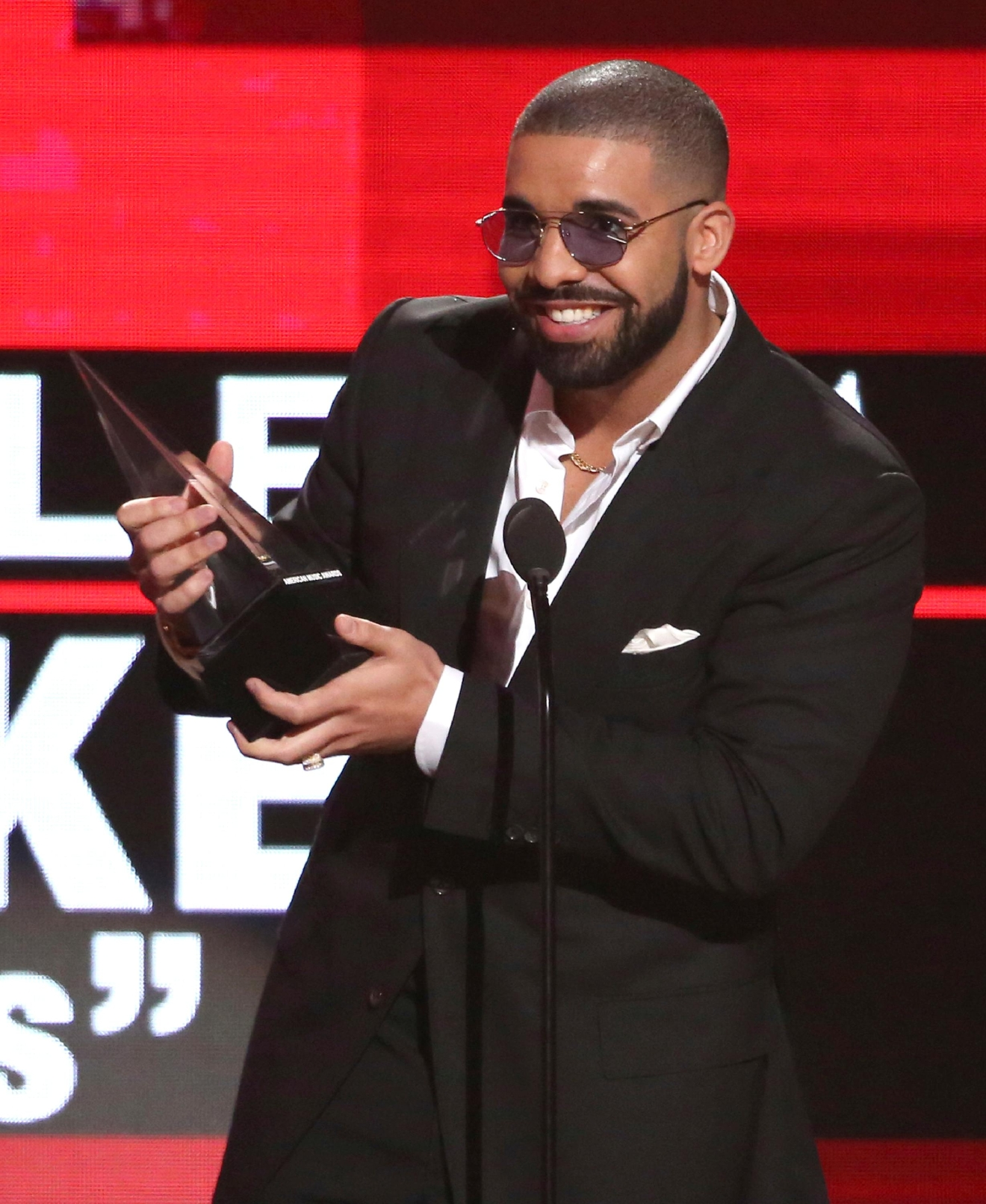 "FILE - In this Nov. 20, 2016 file photo, Drake accepts the award for favorite album rap/hip-hop for ""Views"" at the American Music Awards in Los Angeles. (Photo by Matt Sayles/Invision/AP, File)"