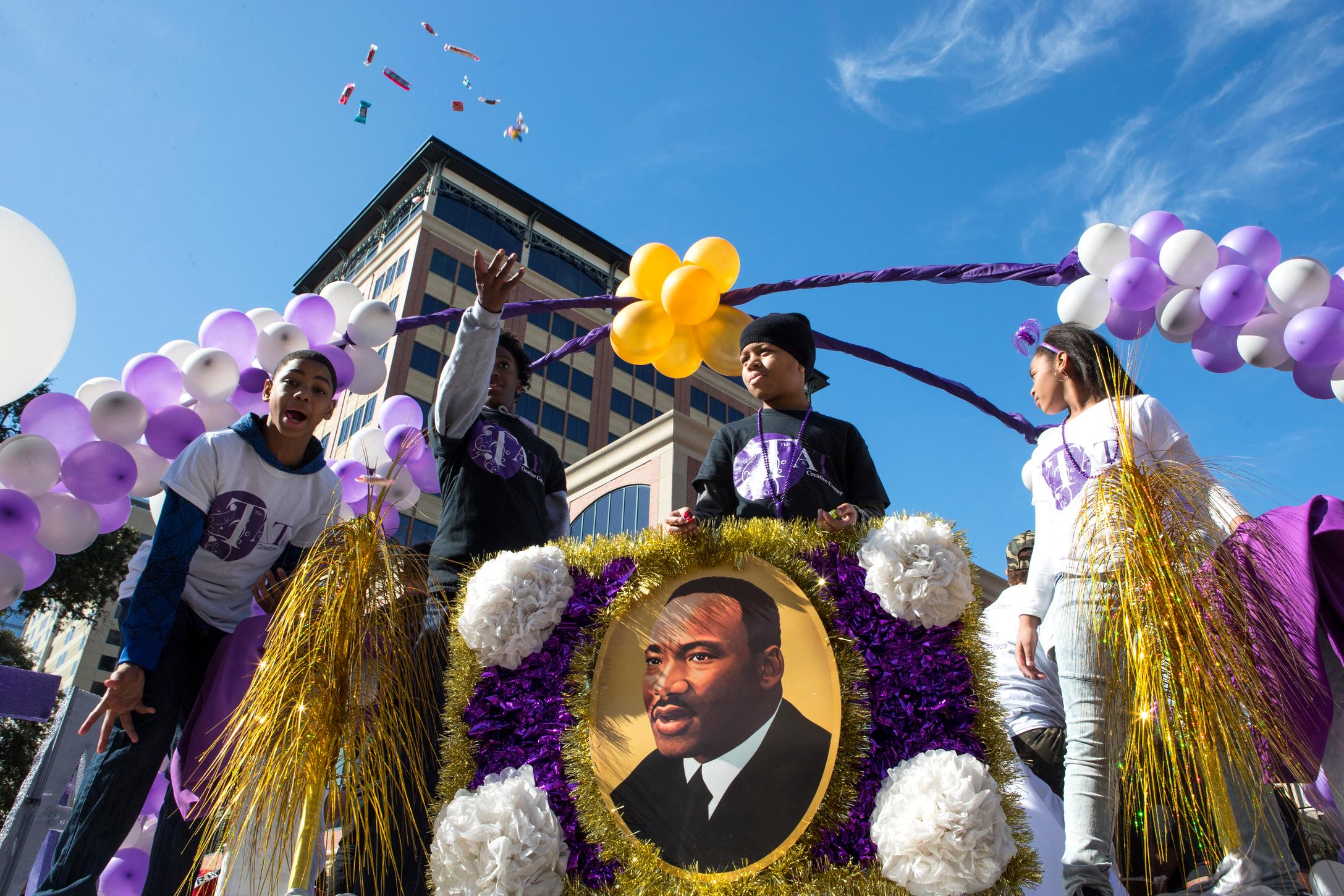 "In this Monday, Jan. 15, 2018 photo candy is thrown from the This and That Creative Corner float during The ""Original"" MLK, Jr. Parade in Houston.(Brett Coomer/Houston Chronicle via AP)"
