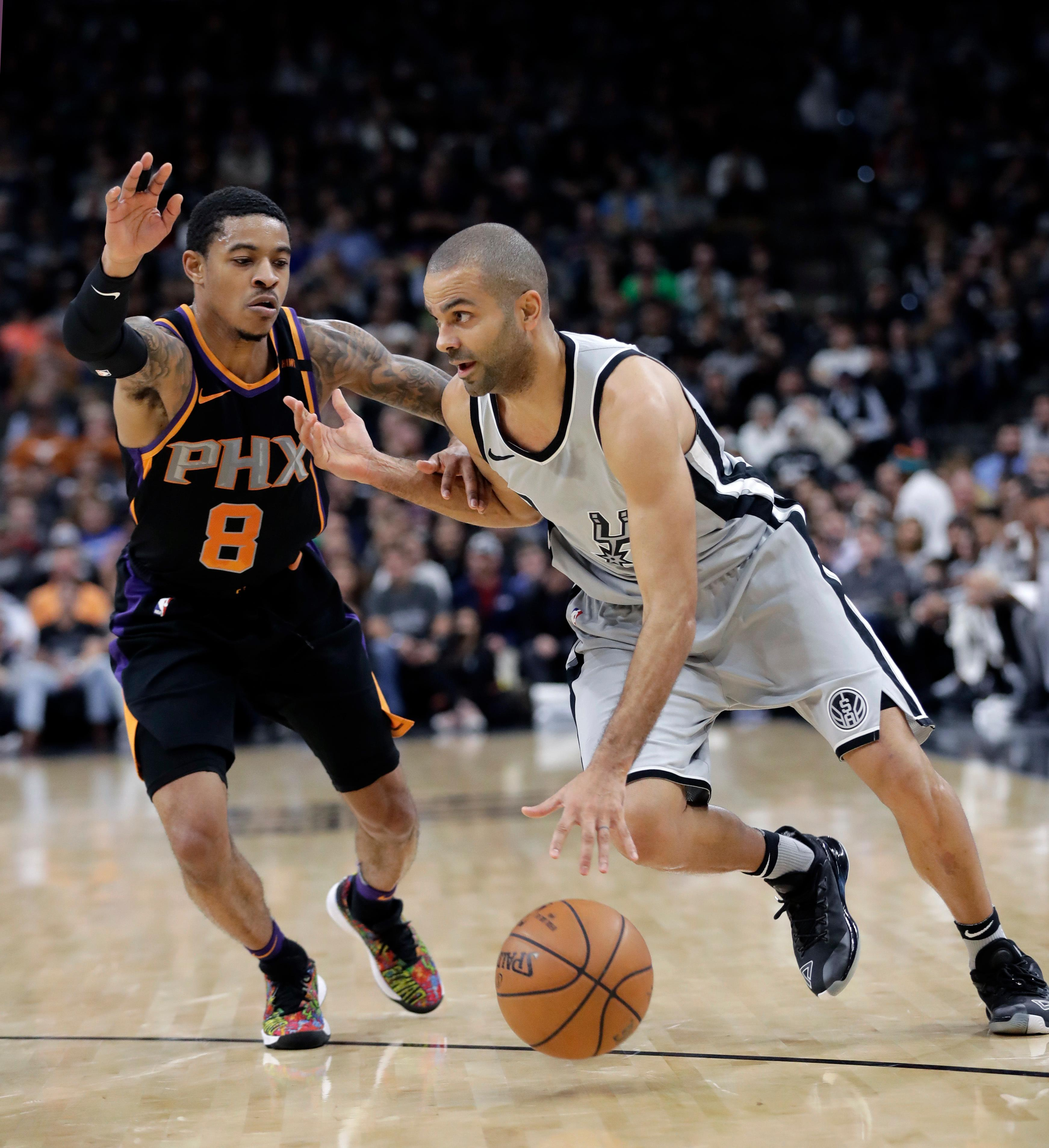 San Antonio Spurs guard Tony Parker (9) drives around Phoenix Suns guard Tyler Ulis (8) during the first half of an NBA basketball game Friday, Jan. 5, 2018, in San Antonio. (AP Photo/Eric Gay)
