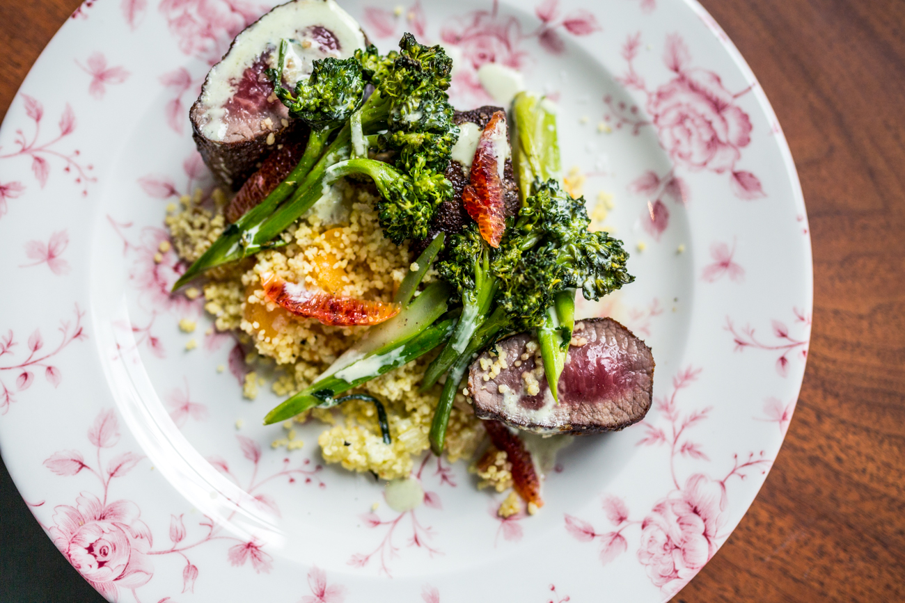Lamb: marinated loin, Israeli couscous, arugula, lemons, dried apricots, tomatoes, broccoli rabe, pine nuts, and herbed greek yogurt / Image: Catherine Viox // Published: 7.31.19<br>