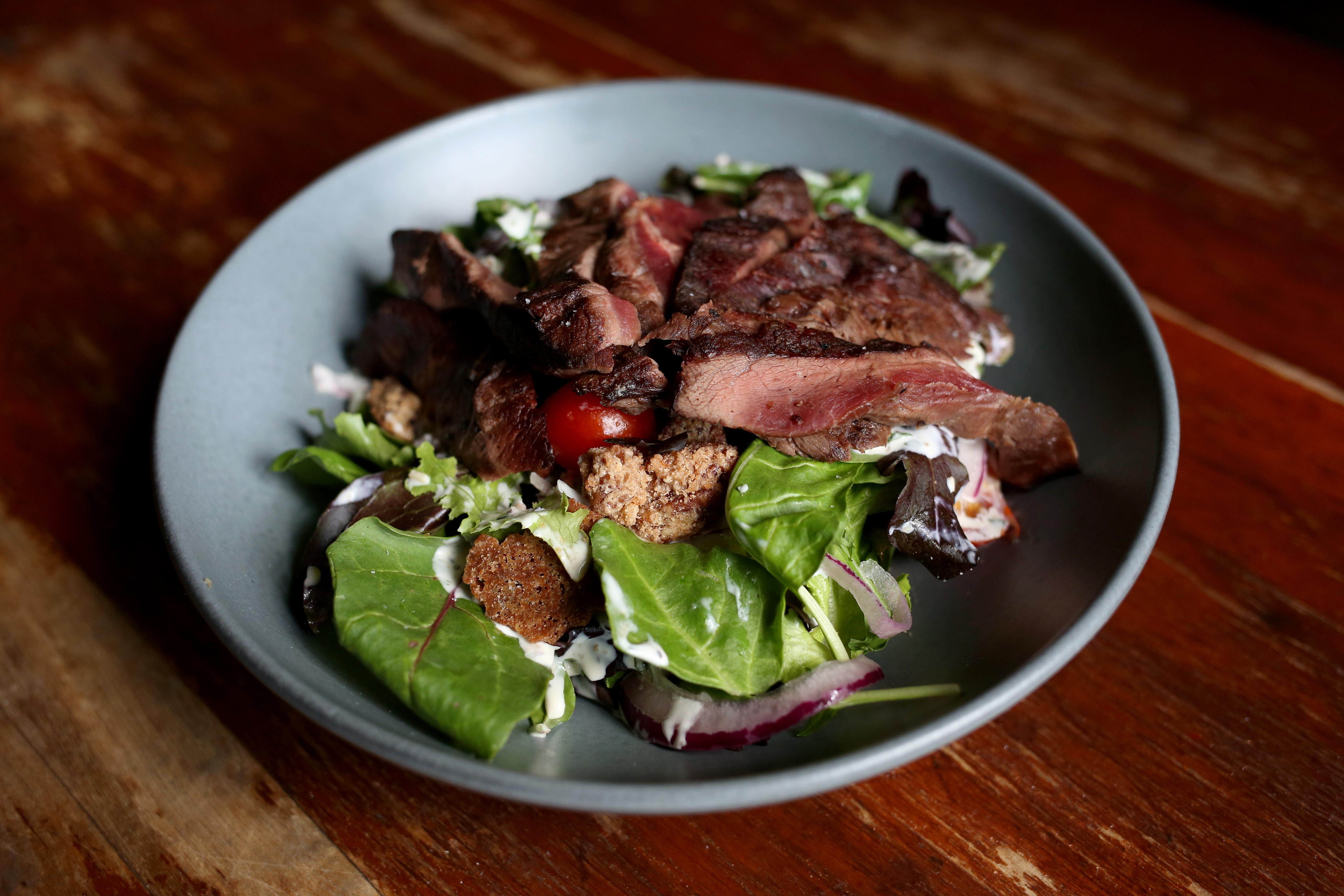 The beef in the steak salad is locally sourced, but don't miss out on the candied pecans.  (Amanda Andrade-Rhoades/DC Refined)