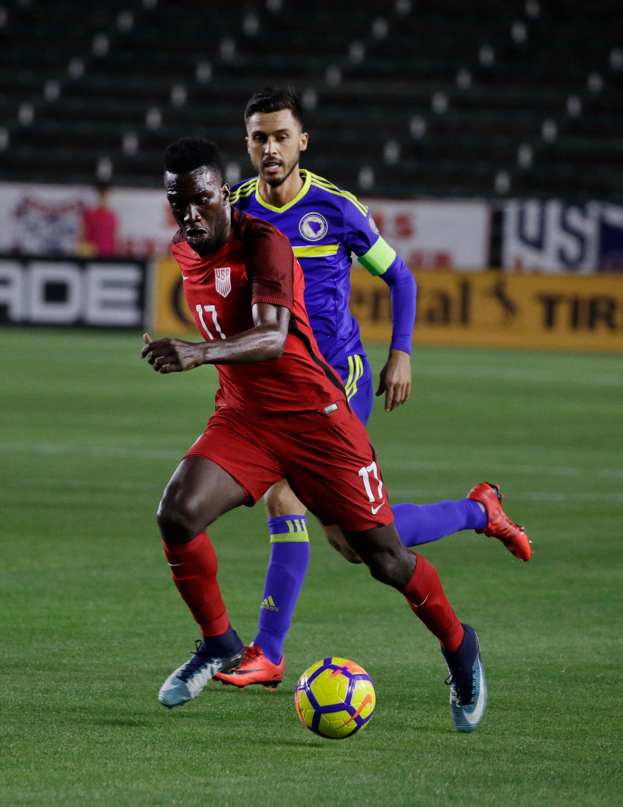 United States forward CJ Sapong, front, controls the ball against Bosnia and Herzegovina midfielder Haris Medunjanin during the first half of an international friendly soccer match on Sunday, Jan. 28, 2018, in Carson, Calif. (AP Photo/Jae C. Hong)