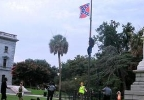 b41b868b-3c7b-4139-8d38-f6b222cd7ef0-ap_woman_removes_confederate_flag_62715_296.jpg