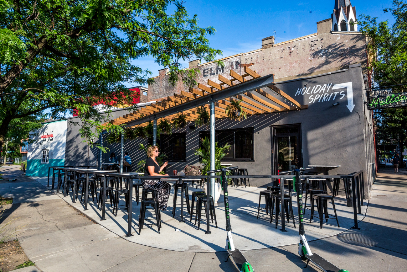 PLACE: Holiday Spirits / ADDRESS: 1538 Race Street (45202) / Holiday Spirits' patio is the perfect space to enjoy a pita sandwich from Forty Thieves along with an ice cold beer. Find it at the corner of Race and Liberty Streets in Over-the-Rhine. / Image: Catherine Viox // Published: 7.7.19