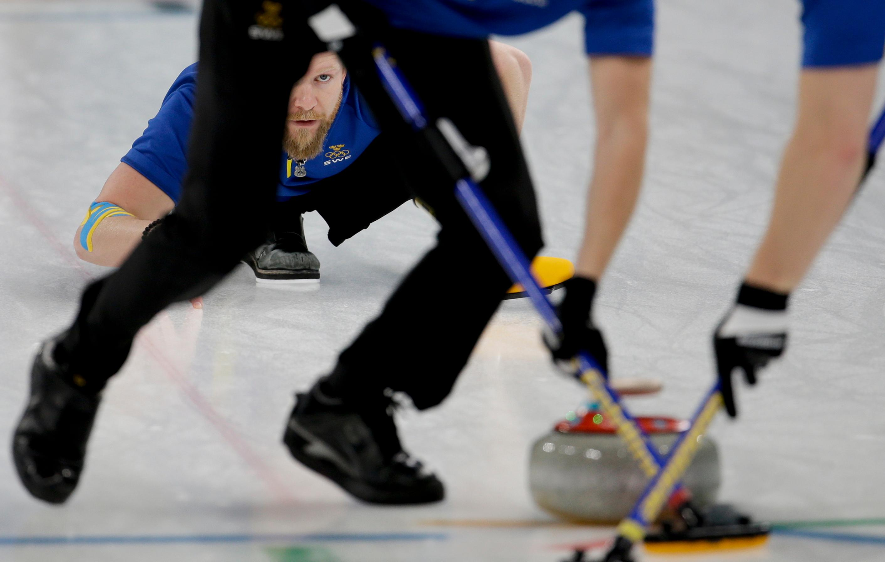 Sweden's skip Niklas Edin watches his teammates sweep the ice during the men's final curling match against THE United States at the 2018 Winter Olympics in Gangneung, South Korea, Saturday, Feb. 24, 2018. (AP Photo/Natacha Pisarenko)