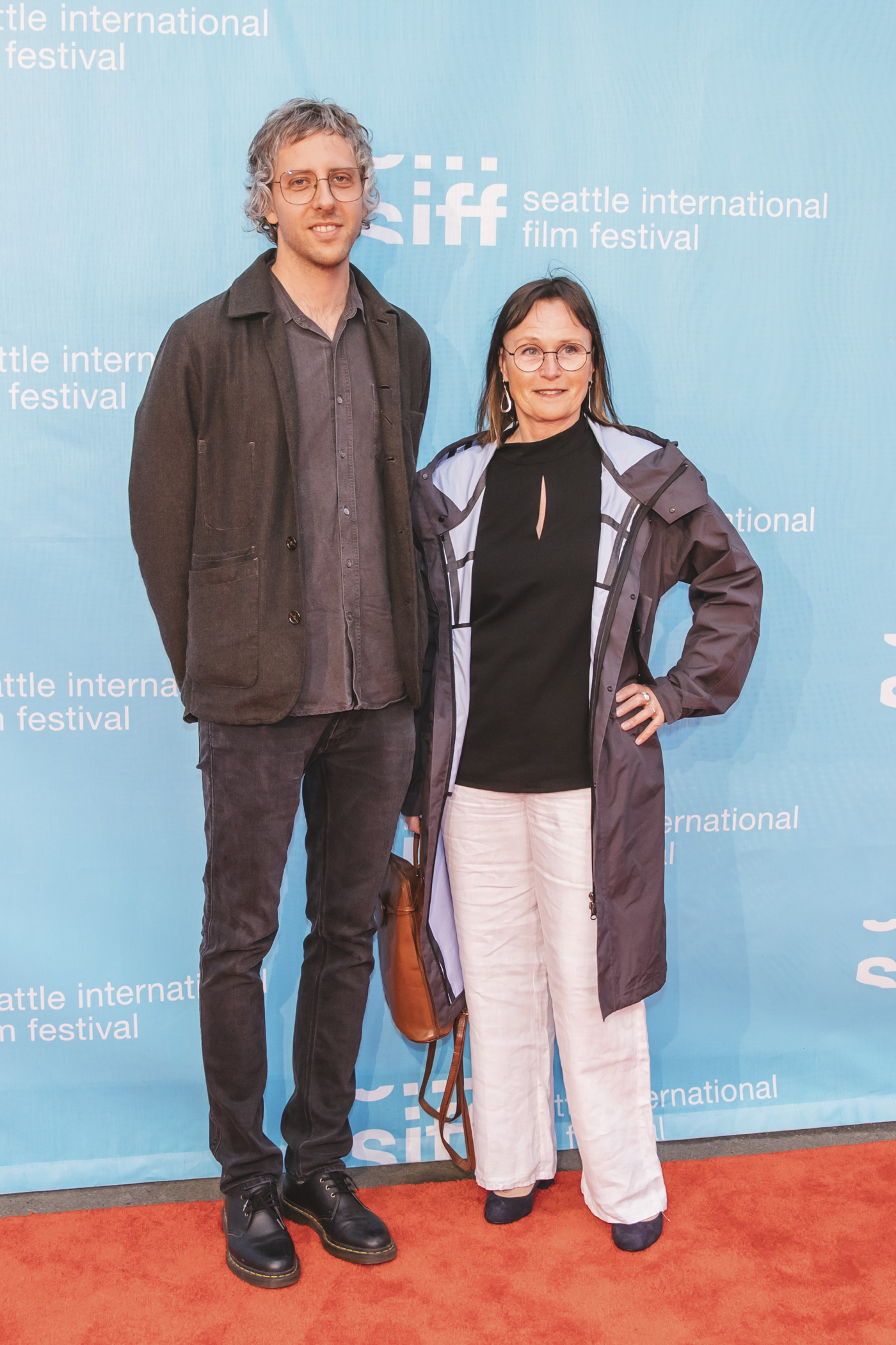 Filmmakers and guests walk the red carpet which marks the beginning of the 25-day Seattle International Film Festival at Seattle Center's McCaw Hall. (Sunita Martini / Seattle Refined)