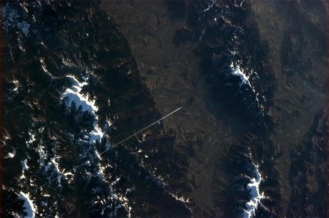 A lone jet draws a straight line across the Tatras. (Photo & Caption: Col. Chris Hadfield, NASA)