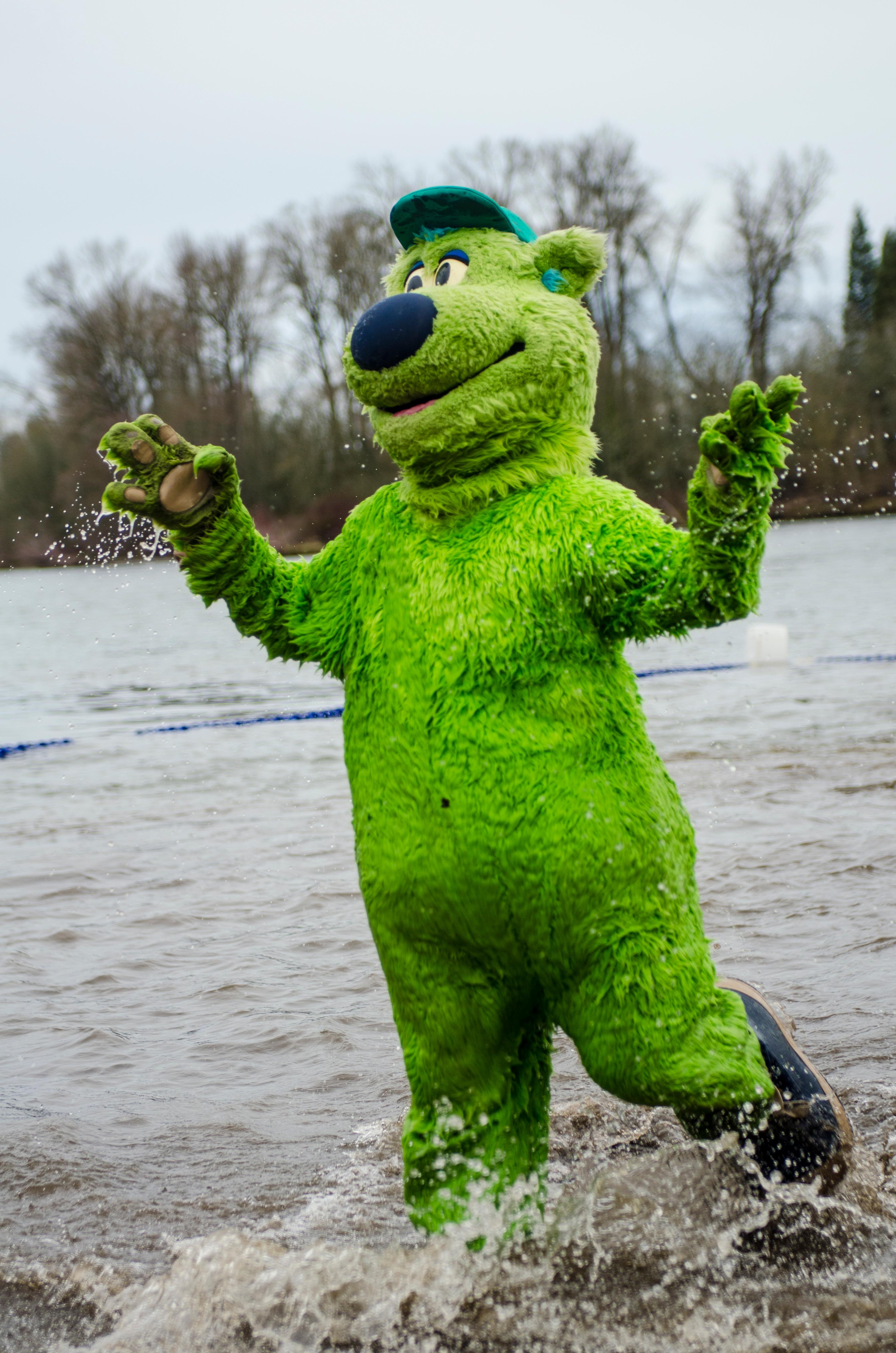 The Eugene Emerald baseball team mascot Sluggo.� Plungers and onlookers gather for the annual Special Olympics Polar Plunge at Maurie Jacobs Park in Eugene. With over 250 plungers diving into the Willamette River, participants look to surpass $412,000, which was last years total. Eugene is just one of the five locations around Oregon that hosts the plunge, but is a nationwide event. The funds raised by todayâ��s plunge will go towards assisting Oregon Special Olympic teams. Photo by Kara Jenness, Oregon News Lab.