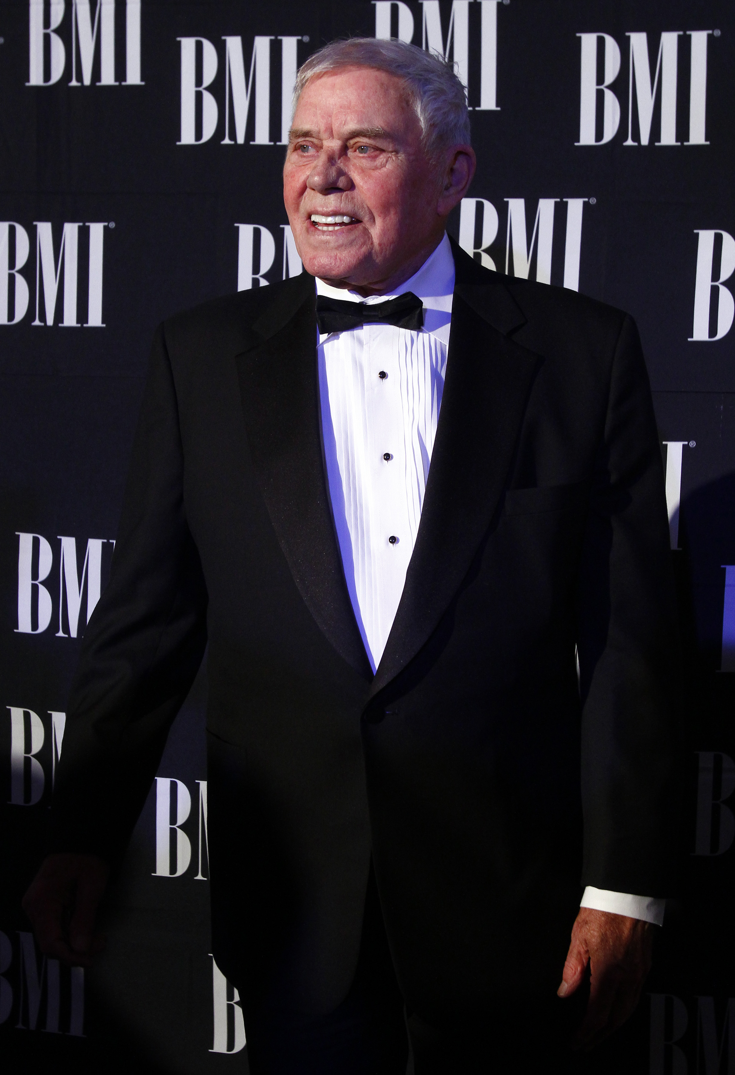 FILE - In this Oct. 30, 2012 file photo, Tom T. Hall arrives at the 60th Annual BMI Country Awards in Nashville, Tenn. Missy Elliott is making history as the first female rapper inducted into the Songwriters Hall of Fame, whose 2019 class also includes legendary British singer Cat Stevens and country-folk icon John Prine, as well as songwriter Hall, and others announced Saturday, Jan. 12, 2019, by the organization. (Photo by Wade Payne/Invision/AP, File)