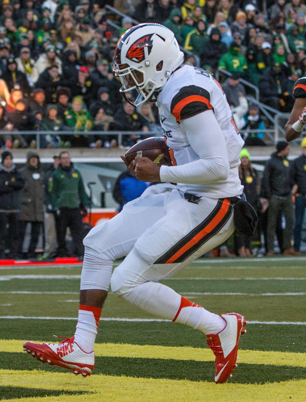 Oregon State Beavers Marcus McMaryion (#3) scores a touchdown in the second half. The Oregon Ducks beat the Oregon State Beavers 52-42 in the 119th Civil War for the eighth year in a row at Autzen Stadium on Friday afternoon. Katie Pietzold, Oregon News Lab