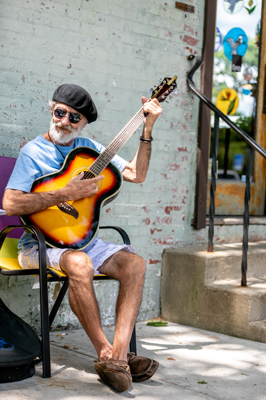 Songwriter and musician Bo Roth plays a newly written song outside one of Yellow Springs many art galleries.  / Image: Amy Elisabeth Spasoff // Published: 8.10.18