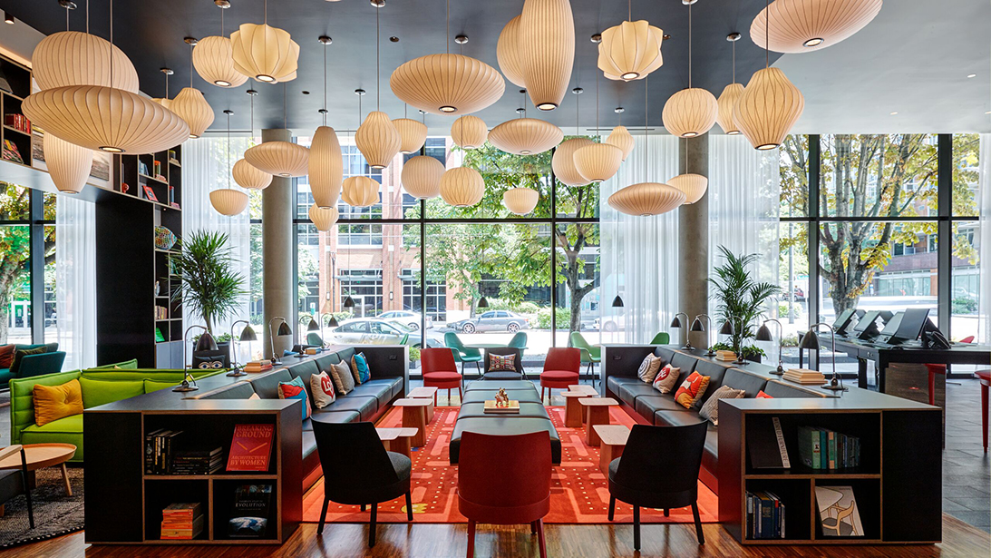 "Say hello to citizenM's new hotel in South Lake Union!{&nbsp;}<a  href=""https://www.gensler.com/"" target=""_blank"" title=""https://www.gensler.com/"">Gensler Seattle</a>{&nbsp;}partnered with{&nbsp;}<a  href=""https://www.citizenm.com/"" target=""_blank"" title=""https://www.citizenm.com/"">the Dutch hotel and lifestyle company</a>{&nbsp;}to design and build this hotel. It's also citizenM's first hotel opening of 2020 and very first on the West Coast.{&nbsp;}<a  href=""https://www.citizenm.com/hotels/united-states/seattle/seattle-south-lake-union-hotel"" target=""_blank"" title=""https://www.citizenm.com/hotels/united-states/seattle/seattle-south-lake-union-hotel"">This hotel</a>{&nbsp;}is the first fully modular hotel in Seattle, meaning it used modular construction (228 modules to be exact), fully finished in a factory to reduce the impacts traditional construction can have on traffic, air quality and emissions. Its technology meets art — the first thing you see outside is a large innovation-themed art installation by{&nbsp;}<a  href=""http://ledouxville.com/"" target=""_blank"" title=""http://ledouxville.com/"">Jesse LeDoux</a>, who used to be the art director of Sub Pop Records. Inside, you'll find a tech-themed mural by Native American artist{&nbsp;}<a  href=""http://www.jeffreyveregge.com/"" target=""_blank"" title=""http://www.jeffreyveregge.com/"">Jeffrey Veregge</a>. The hotel (201 Westlake Ave N) only has one type of bedroom, food & drink available 24/7, free movies and world-class art. It's also a contactless experience, meaning check-in, all room controls, purchases and soon-to-be request services can be made through a mobile app. (Image: citizenM / Richard Powers Photography)"