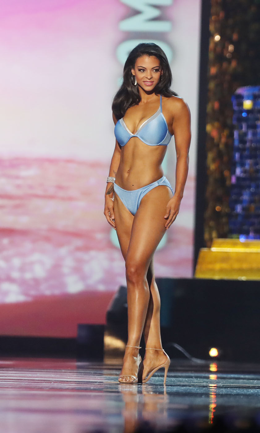 Miss Oklahoma 2017 Triana Browne walks the stage in the fitness portion of the second night of the Miss America 2018 preliminaries at Boardwalk Hall in Atlantic City, NJ. Thursday Sept. 7, 2017 . (Edward Lea/The Press of Atlantic City via AP)