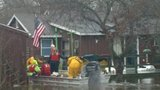 Comstock Fire Department rescues two from homes surrounded by floodwaters