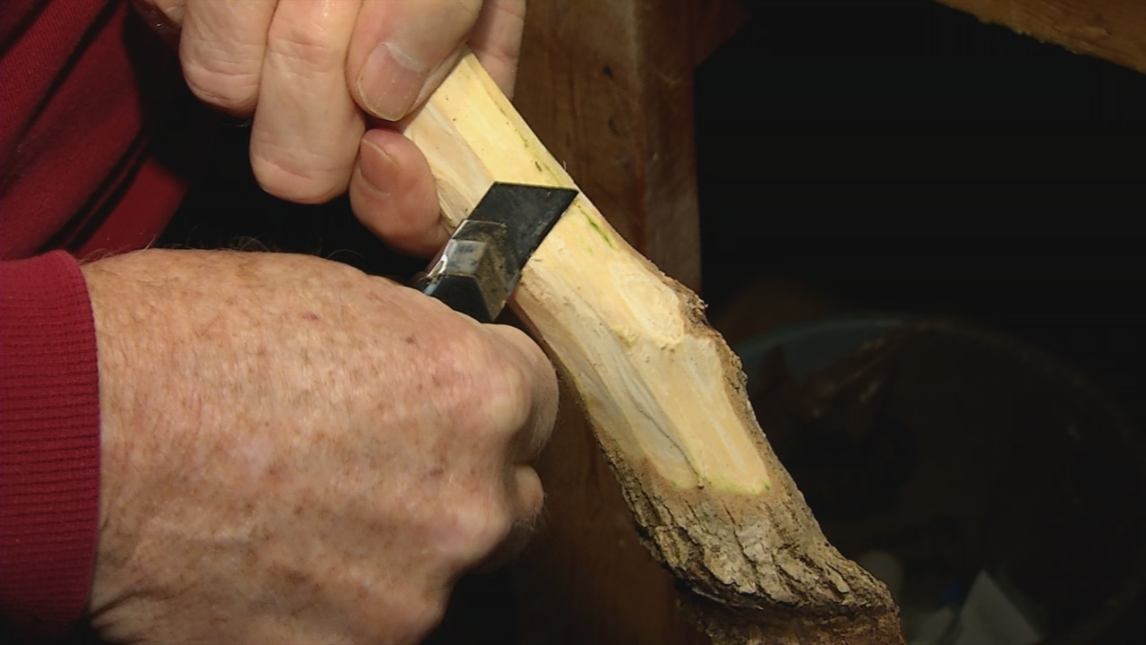 Paul Kelly begins each stick by pealing off the bark, he says he's worn out several pocket knives. (WCHS/WVAH)<p></p>