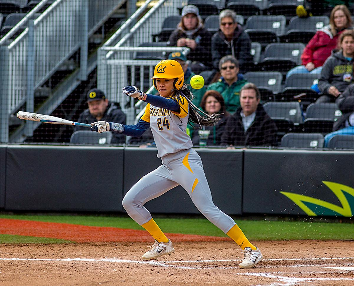 The Golden Bears' Jazmyn Jackson (#24) connects with the ball as she prepares to run. The Oregon Ducks defeated the Cal Golden Bears 2-1 in the second game of the three game series. Photo by August Frank, Oregon News Lab